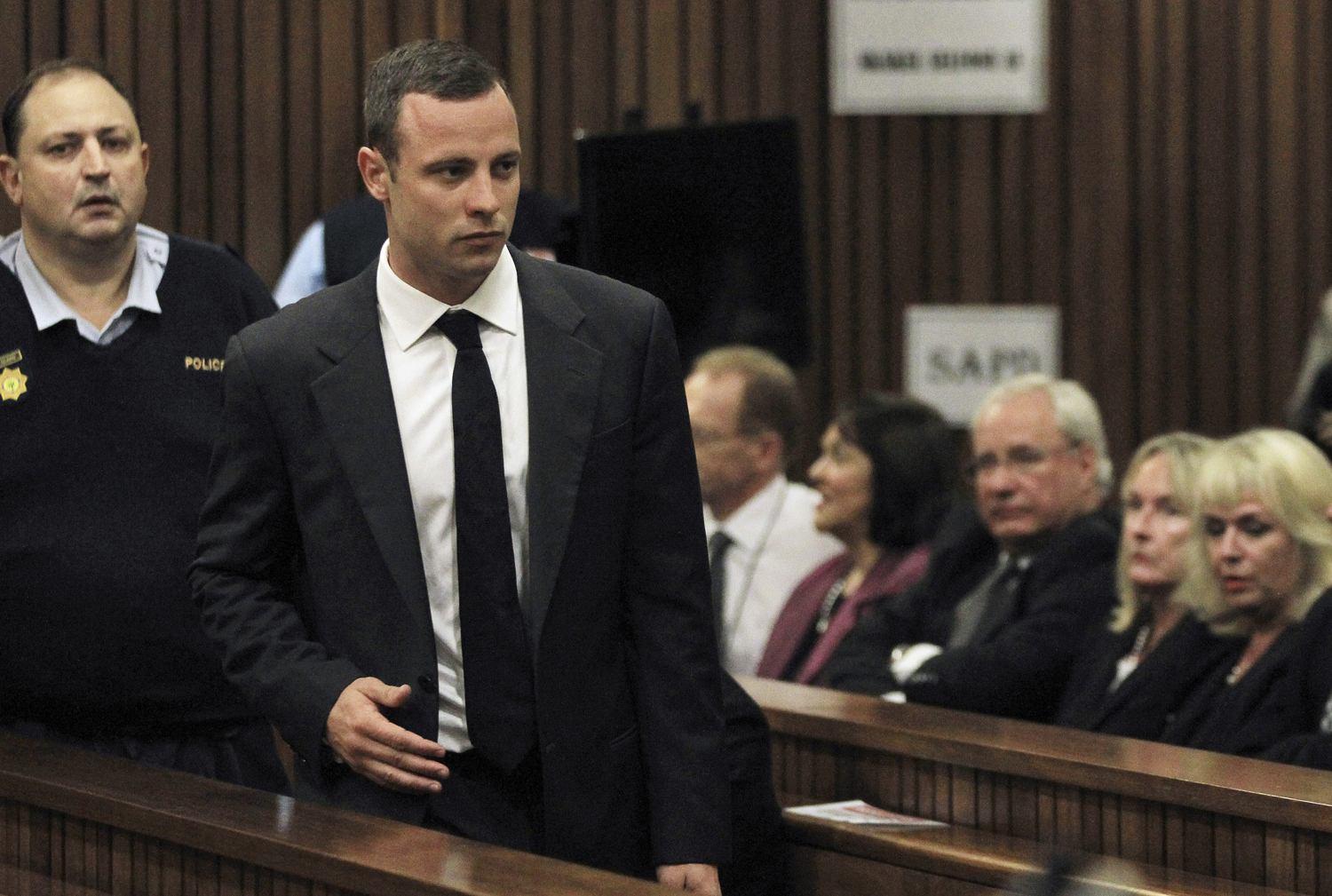 Oscar Pistorius arrives in court ahead of his trial at the North Gauteng High Court in Pretoria Mar. 3, 2014