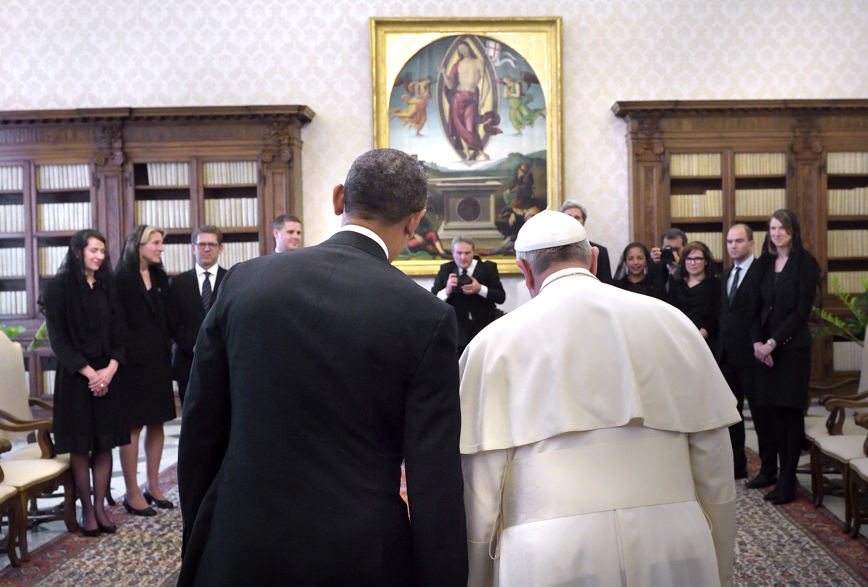 U.S. President Barack Obama speaks with Pope Francis during their meeting at the Vatican March 27, 2014.