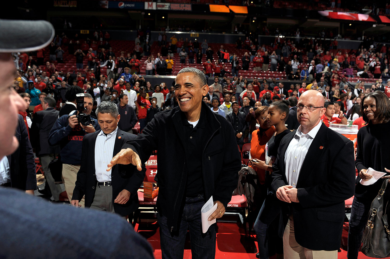 President Obama at a college basketball game between the Oregon State Beavers and the Maryland Terrapins at the Comcast Center on Nov. 17, 2013 in College Park, Maryland.