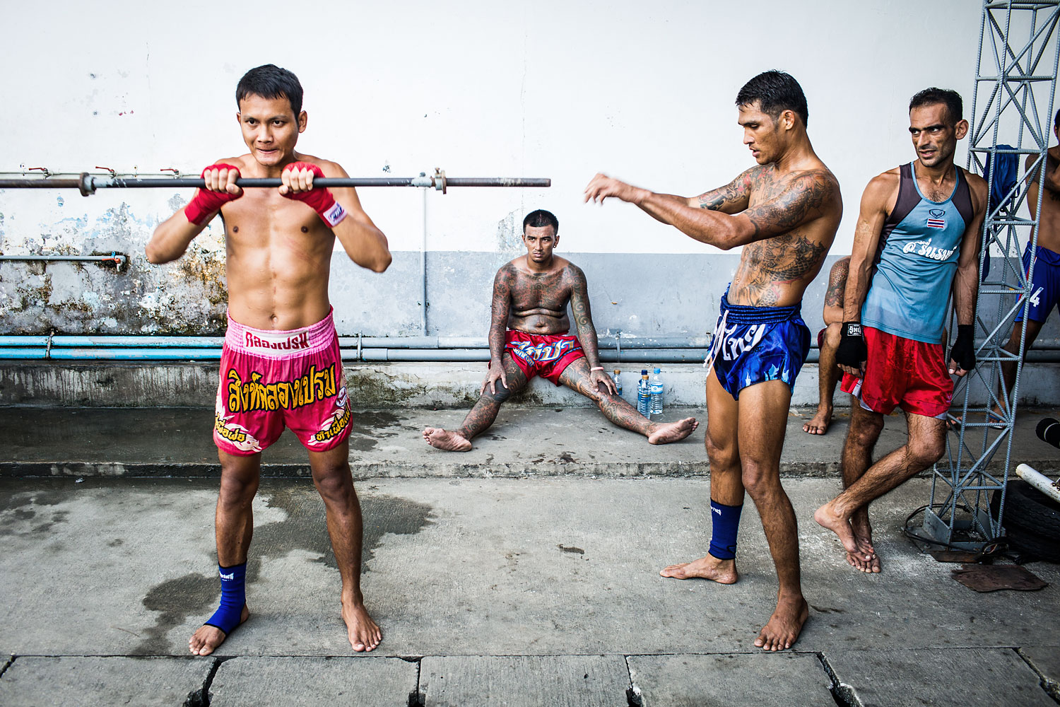 Moo, 23, builds muscle for Muay Thai on the Klong Prem prison yard, in Bangkok, Nov. 2013.