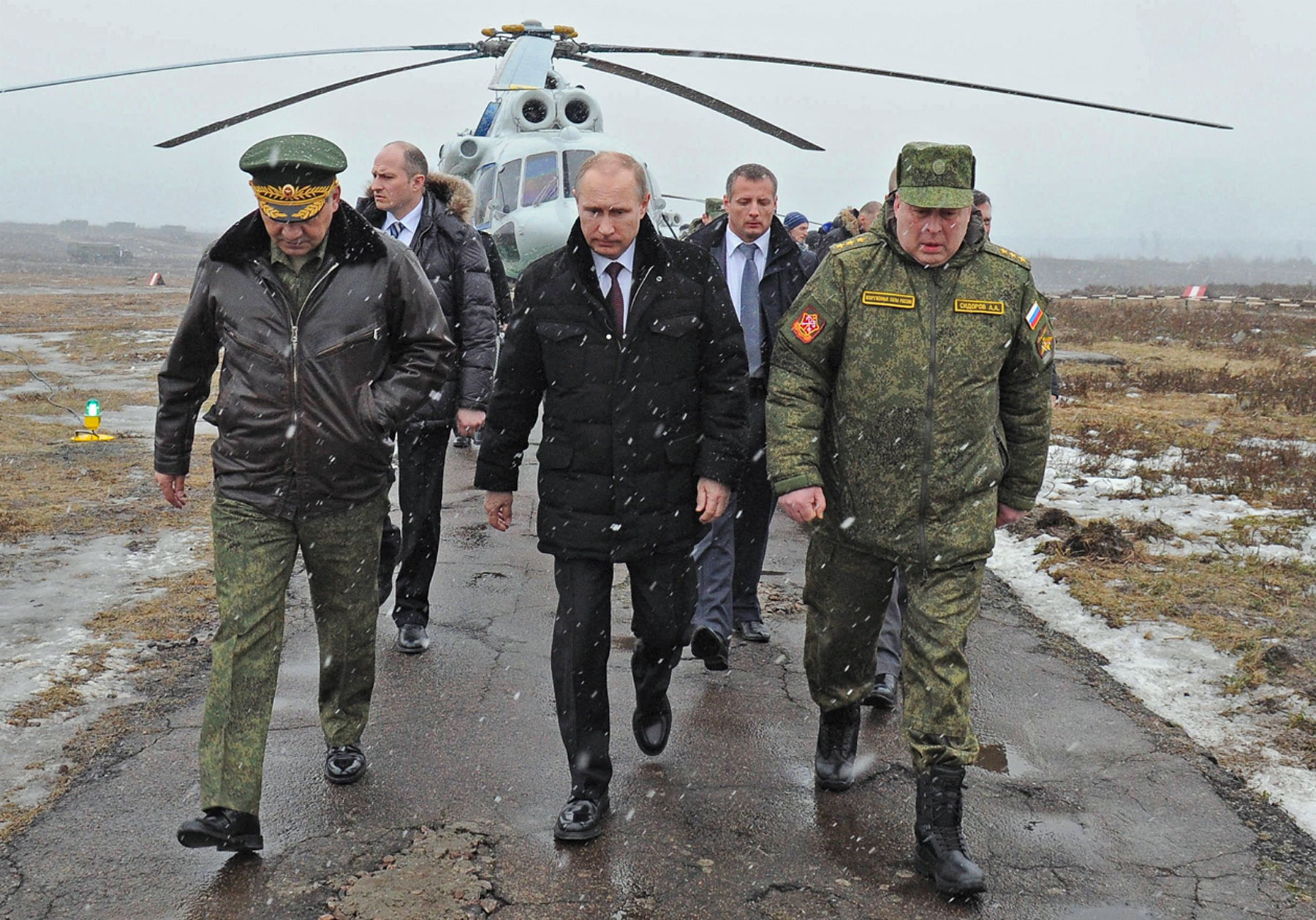 From left: Russia's defence minister Sergei Shoigu, president Vladimir Putin, and commander of the Russian Western Military District Troops Anatoly Sidorov arrive at the Kirillovsky training ground to watch military exercises on Mar.3, 2014.