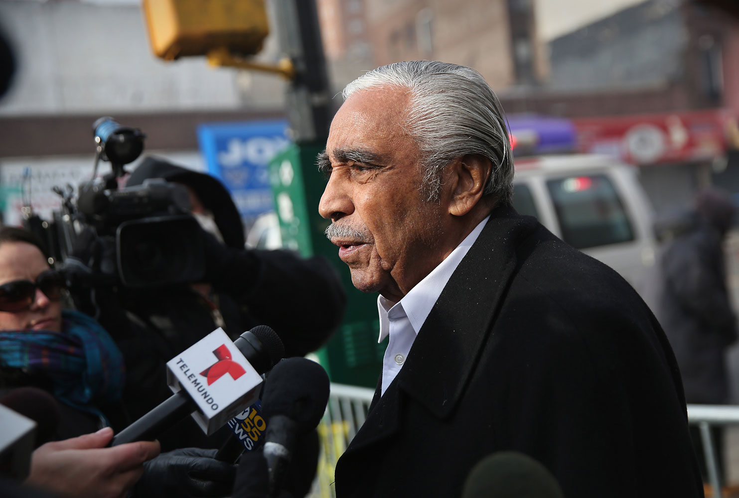 U.S. Rep. Charles Rangel (D-NY), speaks to the media near the smoking site of an explosion in East Harlem on March 13, 2014 in New York City.