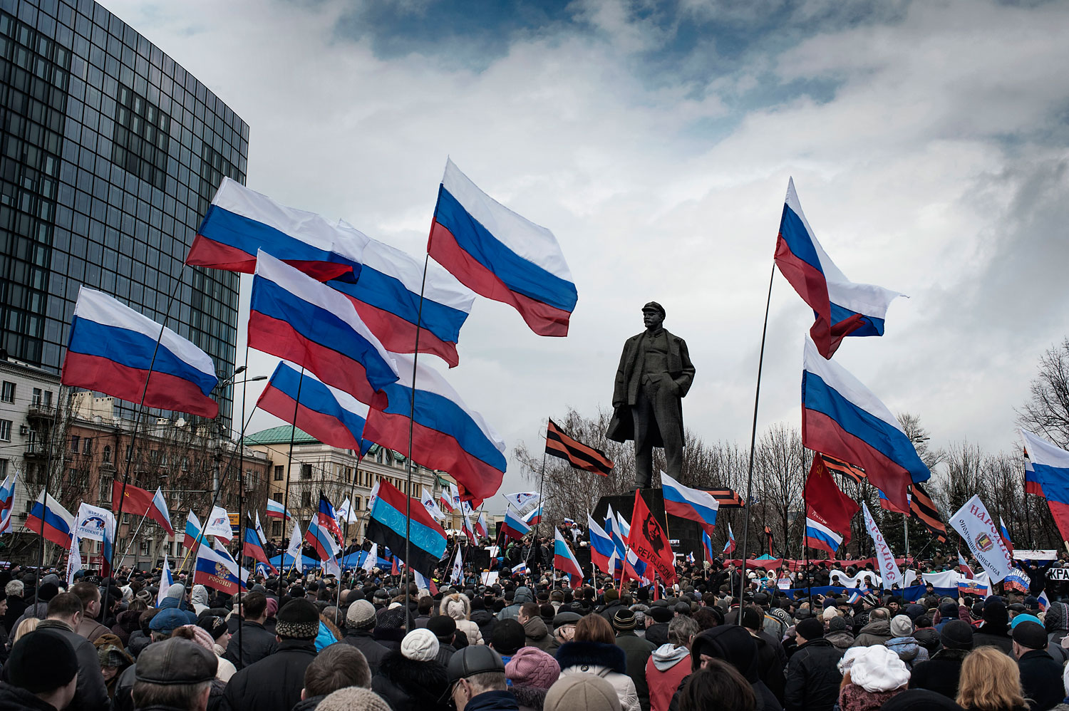 Pro-Russia supporters gather and wave Russian flags in Lenin Square in Donetsk, March 16, 2014.