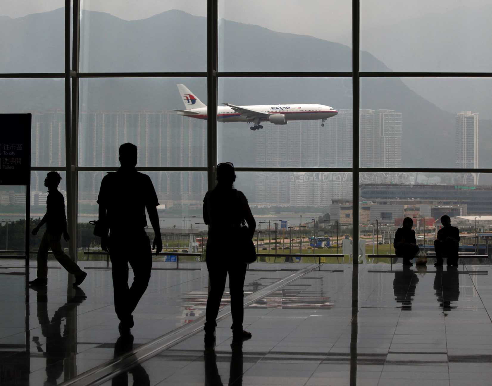 A Malaysia Airlines Boeing 777 plane is seen from the departure hall at the Hong Kong International Airport in a file photo taken in June 2011