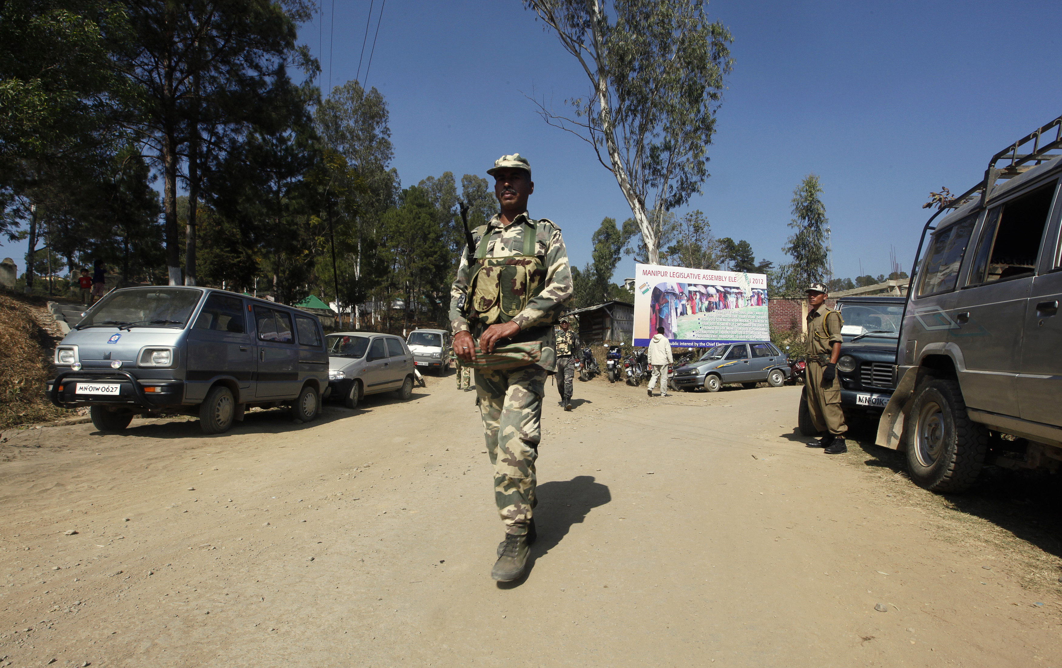 Security-force personnel patrol a village in the Chandel district of Manipur in 2012. The state is home to several insurgent groups who have ramped up the recruitment of child soldiers in recent years