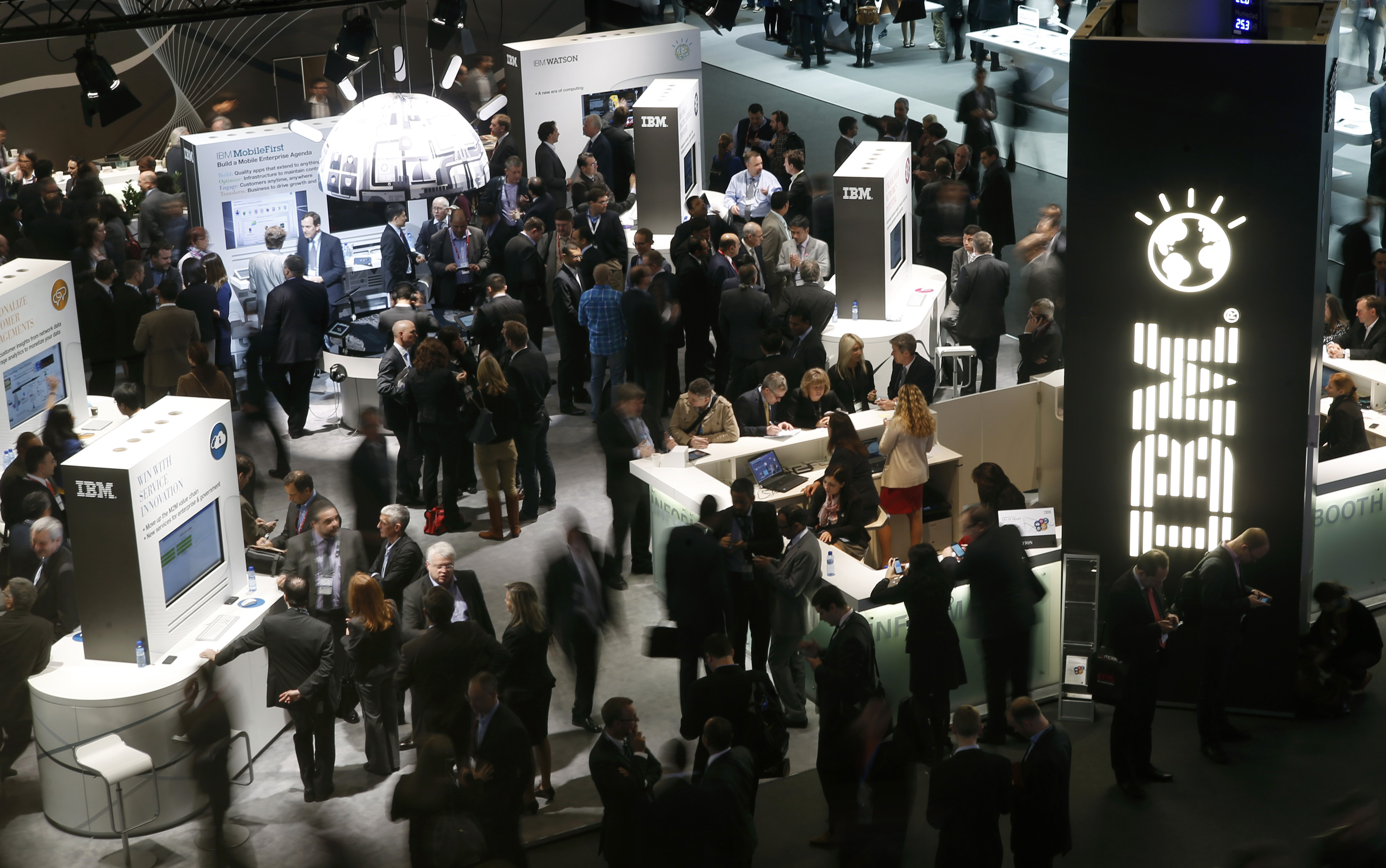 Participants visit the IBM stand at the Mobile World Congress in Barcelona, February 26, 2014.