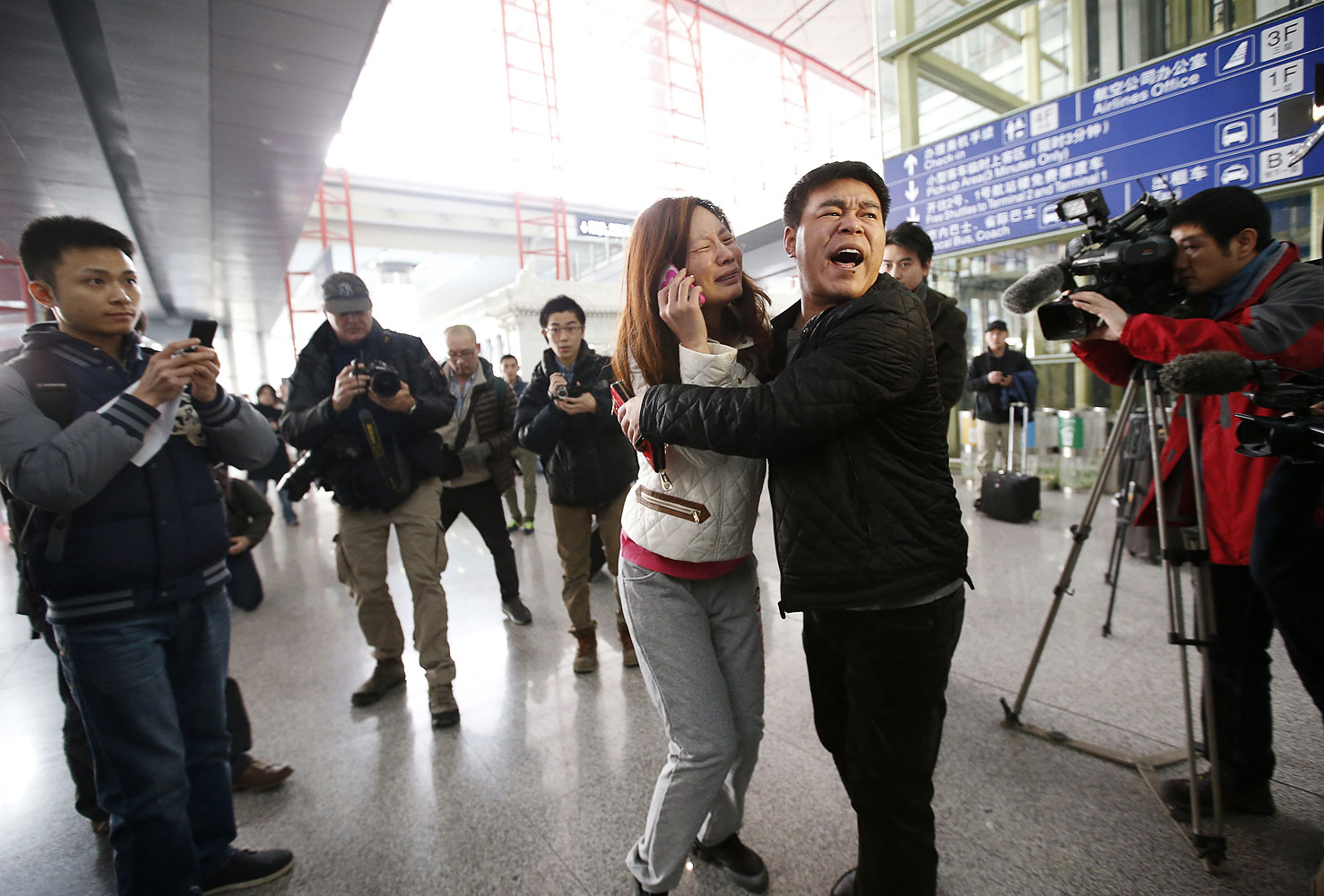 A relative of a passenger onboard Malaysia Airlines flight MH370 at the Beijing Capital International Airport, March 8, 2014.