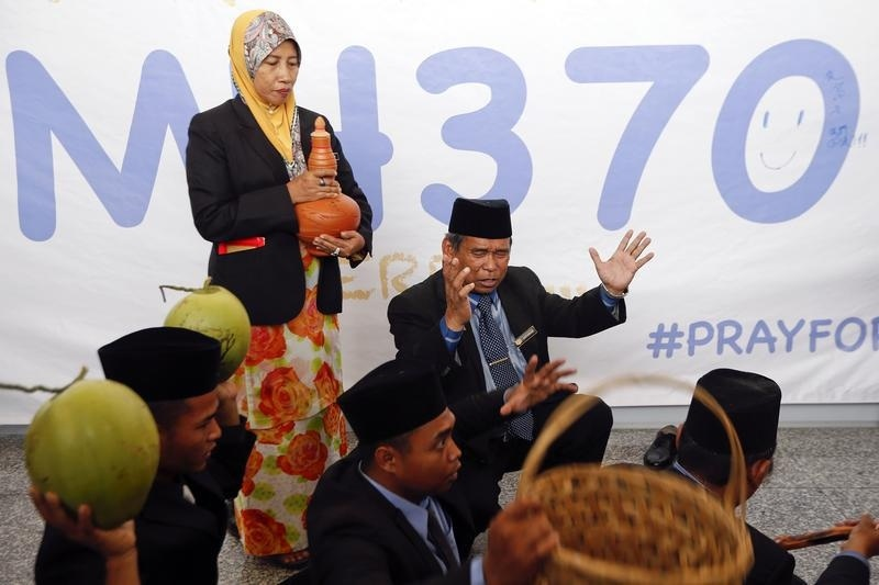 Ibrahim Mat Zin performs a ritual to help find the missing Malaysia Airlines MH370 at Kuala Lumpur International Airport.