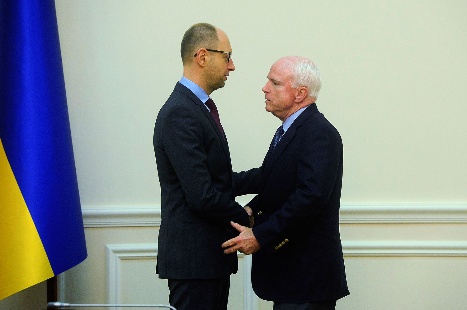 Ukraine's Prime Minister Arseny Yatseniuk, left, meets with Senator John McCain in Kiev March 15, 2014.