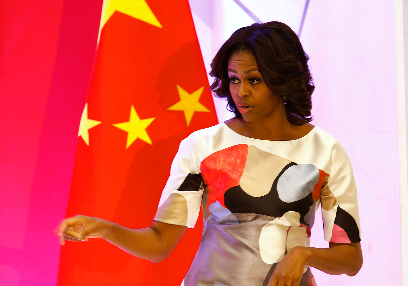 The First Lady, in a multi-toned dress, during a speech at  Peking University in Beijing, March 22, 2014.