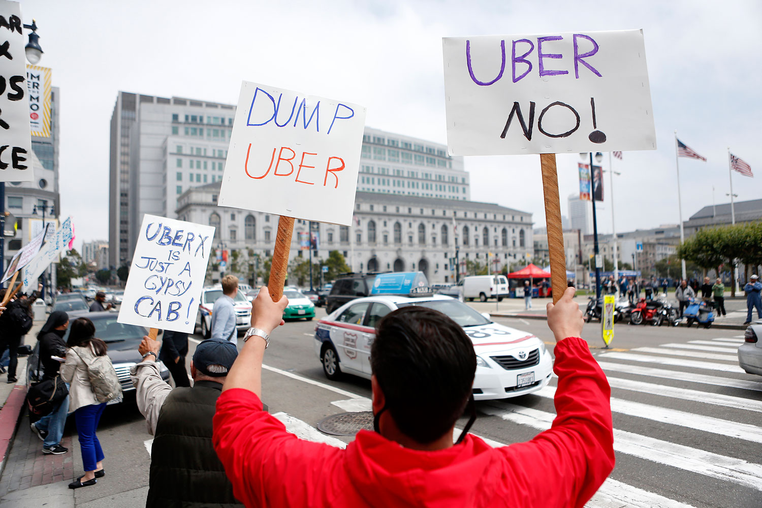San Francisco taxi drivers protest Uber, which taxi drivers say is operating illegally in San Francisco, July 30, 2013.