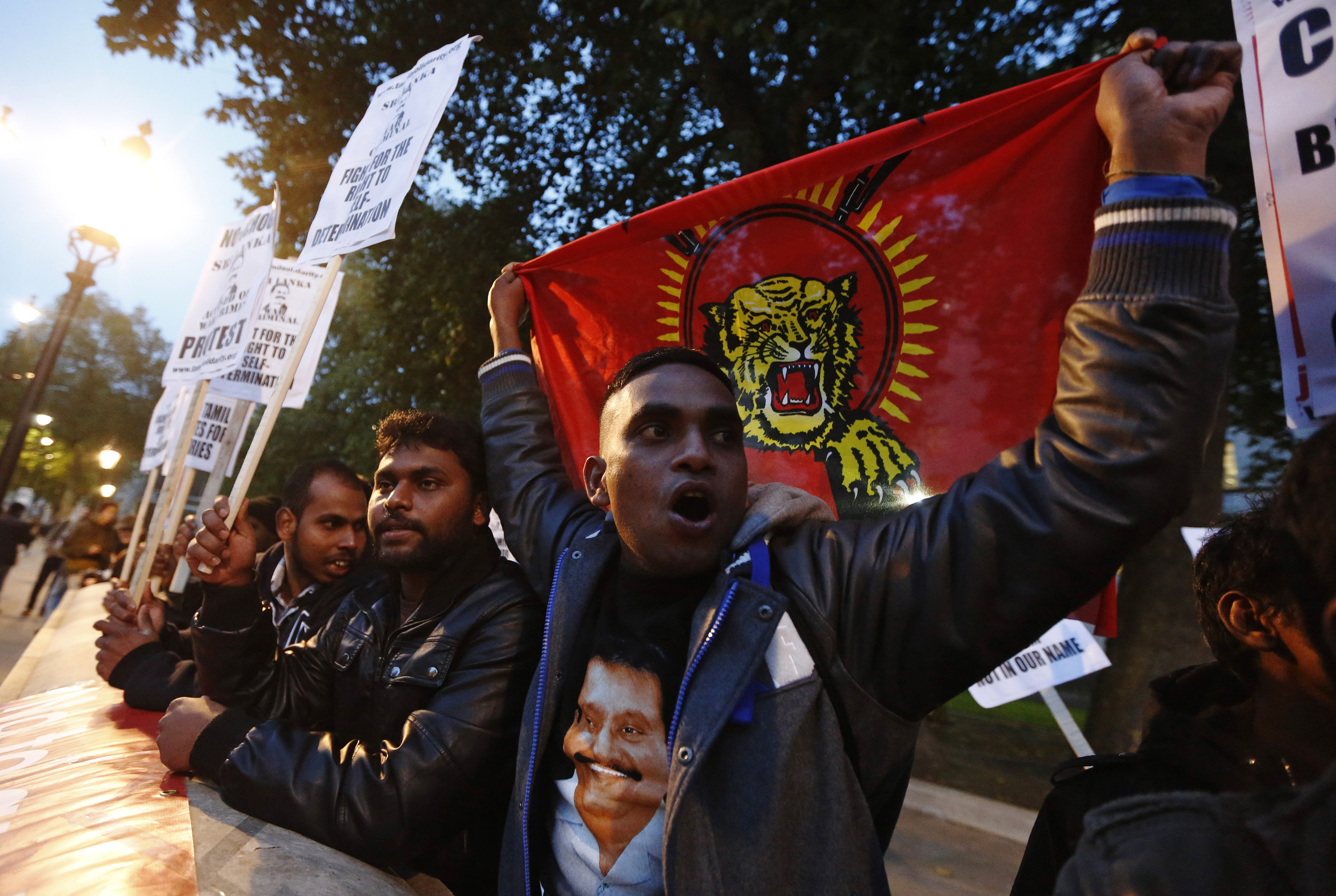 Tamil demonstratorsprotest Sri Lanka's human rights record outside Downing Street in  London in November  2013.