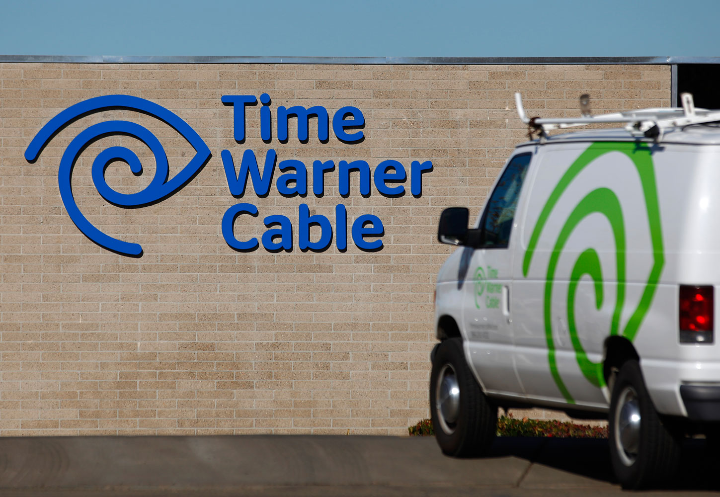 A cable truck returns to a Time Warner Cable office in California, Dec. 11, 2013.