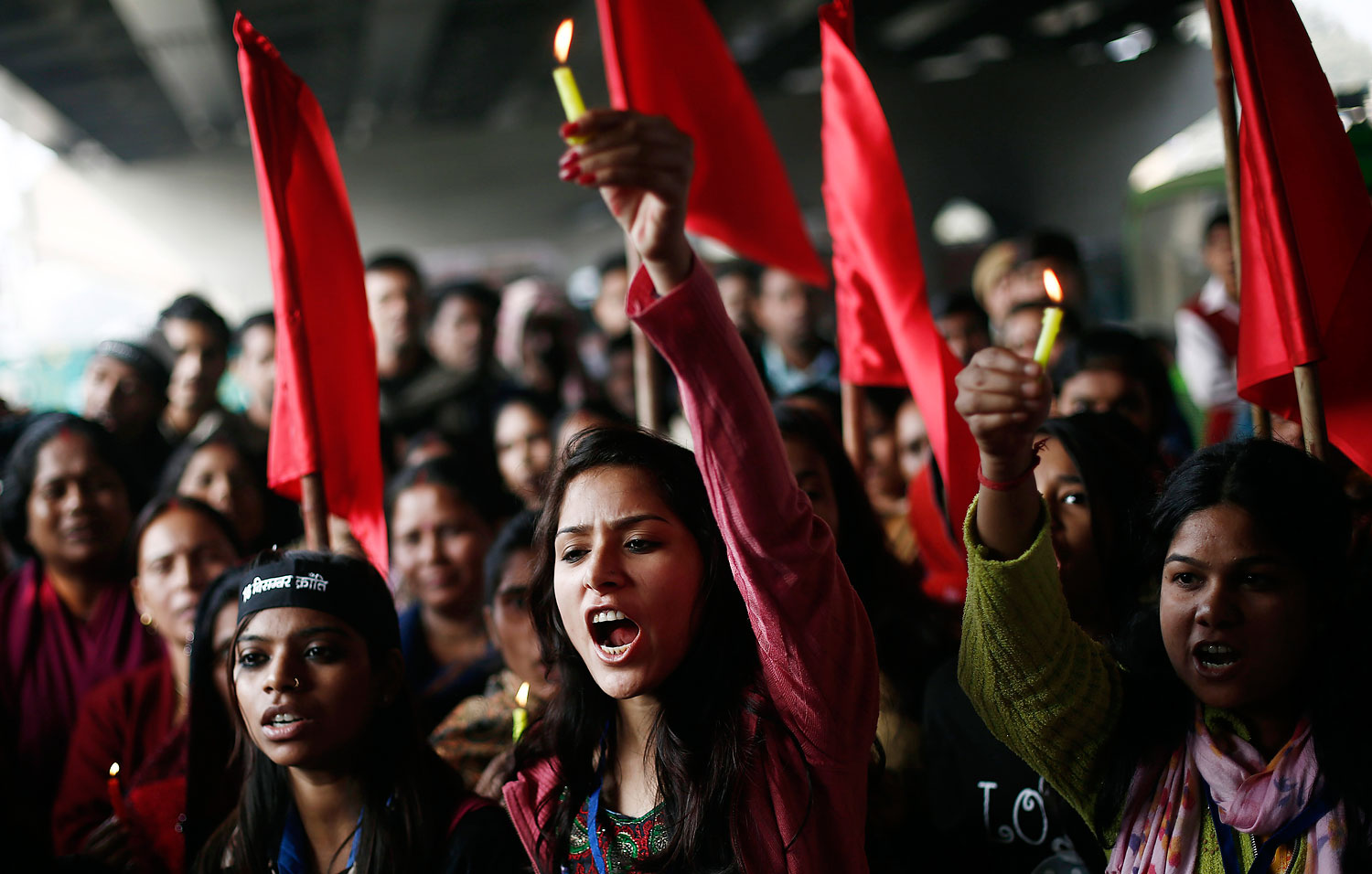 Protesters carry candles as they shout slogans during a protest to mark the first anniversary of the Delhi gang rape, in New Delhi Dec. 16, 2013.