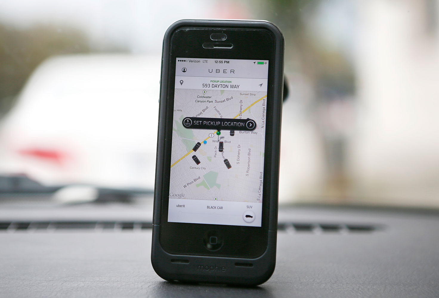 An Uber app is seen on an iPhone in Beverly Hills, Calif., on Dec. 19, 2013.
