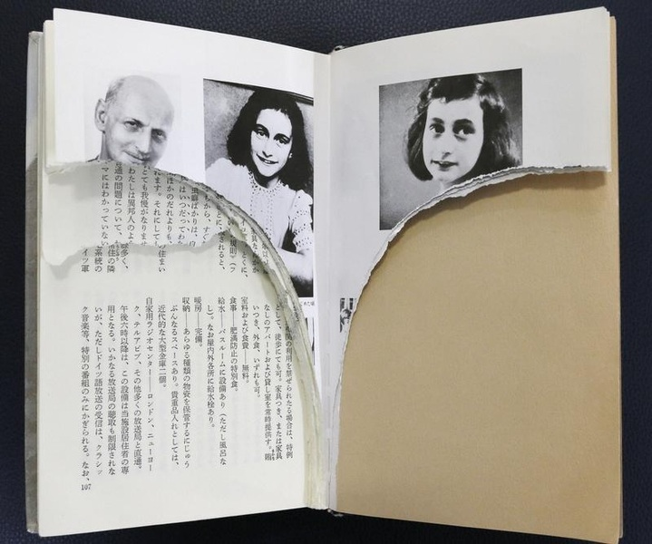 Ripped pages of Anne Frank's  Diary of a Young Girl  are pictured at a library in Tokyo in February 2014.