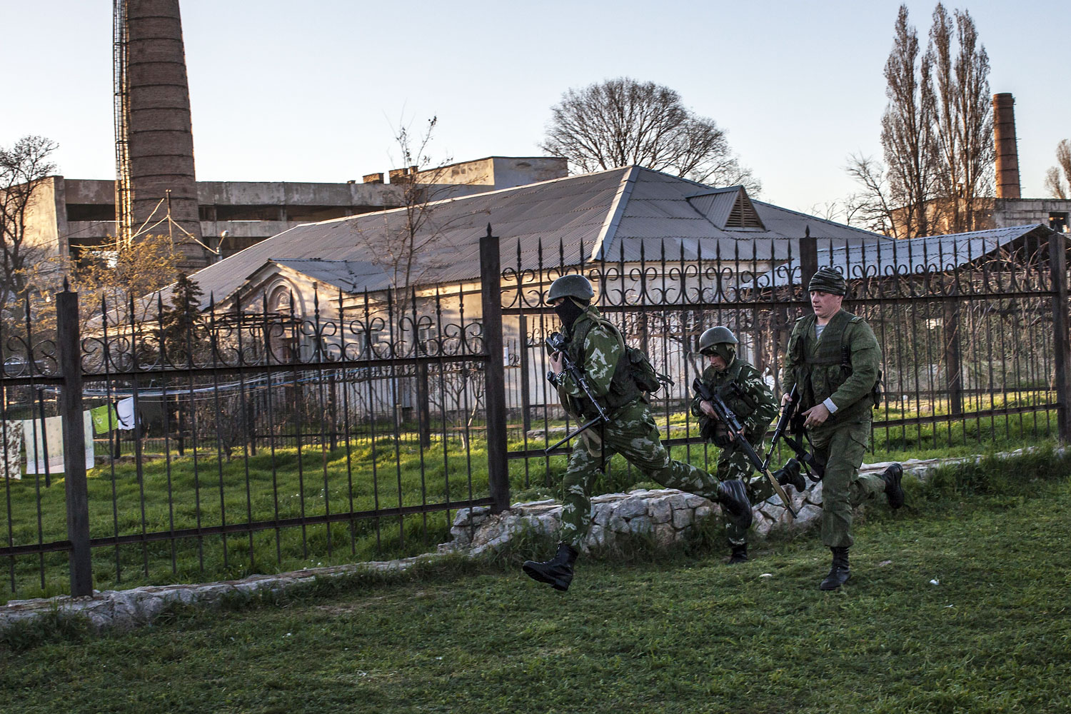 Russian forces storm a Ukrainian military base in the village of Belbek, Crimea, March 22, 2014.