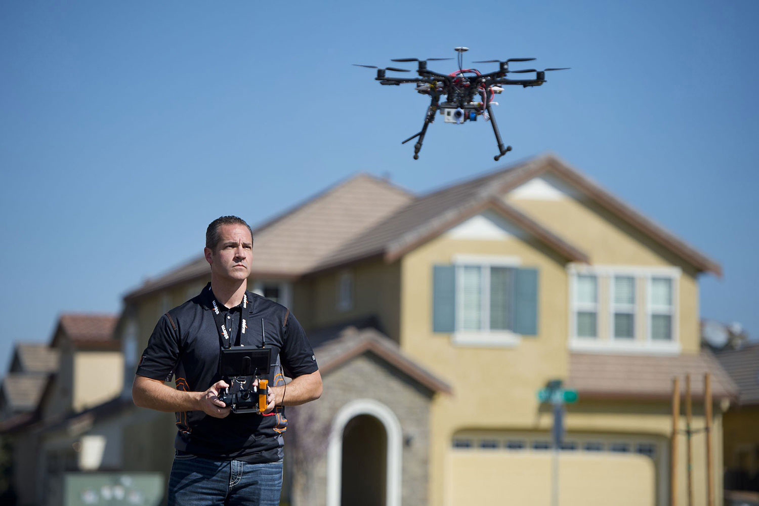 Christopher Brown, co-owner of Next New Homes Group, uses his multi-rotor helicopter drone to take aerial video of a home in Sacramento, Calif., on Feb. 25, 2014.