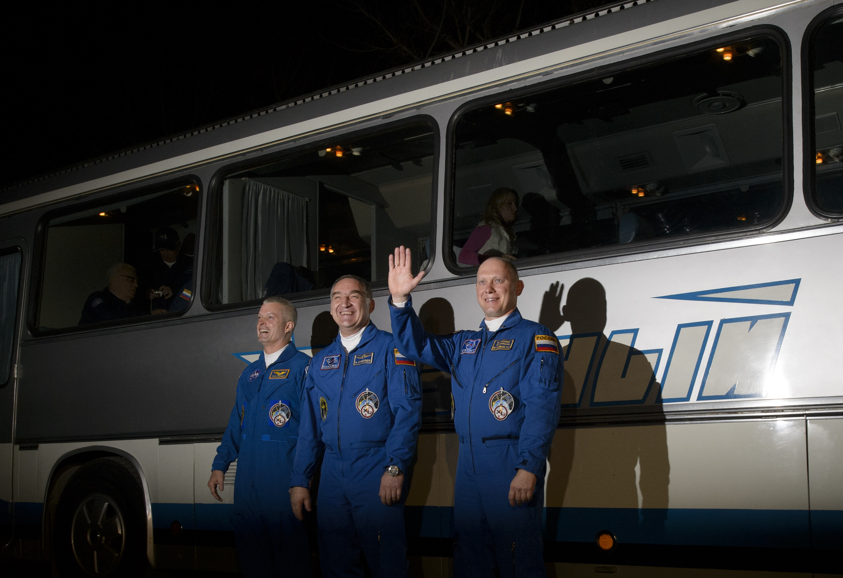 American astronaut Steve Swanson, left, and cosmonauts Alexander Skvortsov and Oleg Artemyev, are seen as they depart the Cosmonaut Hotel, Tuesday, March 25, 2014, in Baikonur, Kazakhstan, prior to their launch aboard a Soyuz rocket