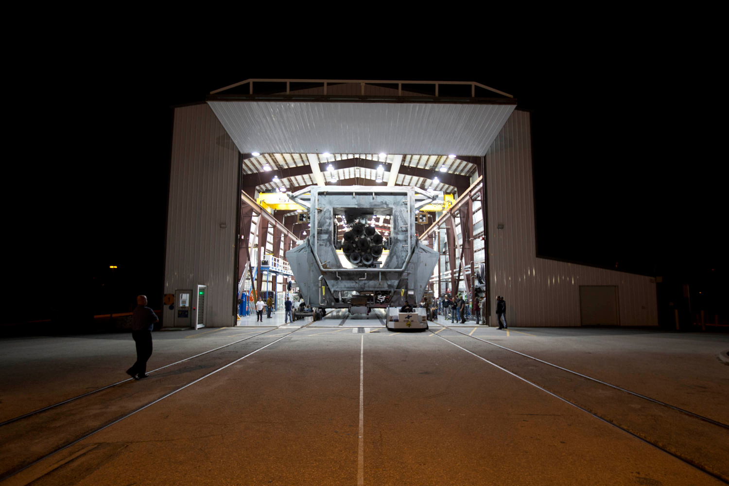SpaceX's Falcon 9 rolls out of the hangar on Nov. 28, 2013.