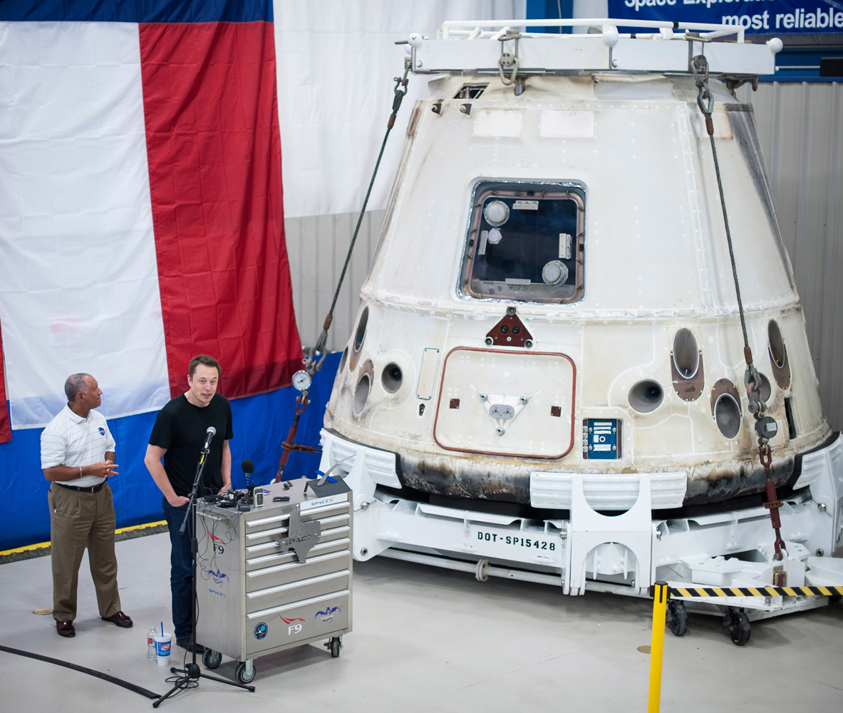 From left: NASA Administrator Charles Bolden and SpaceX CEO and Chief Designer Elon Musk view the Dragon capsule that returned to Earth on May 31, 2012 following the first successful mission by a private company to carry supplies to the International Space Station, at the SpaceX facility in McGregor, Texas, on June 13, 2012.