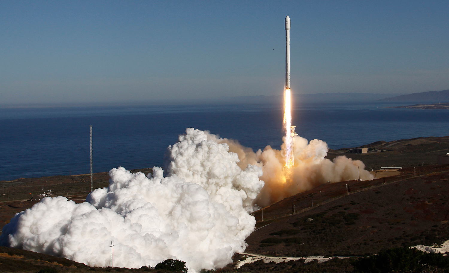 A Falcon 9 rocket carrying a small science satellite for Canada is launched from a newly refurbished launch pad in Vandenberg Air Force Station in California, on Sept. 29, 2013.