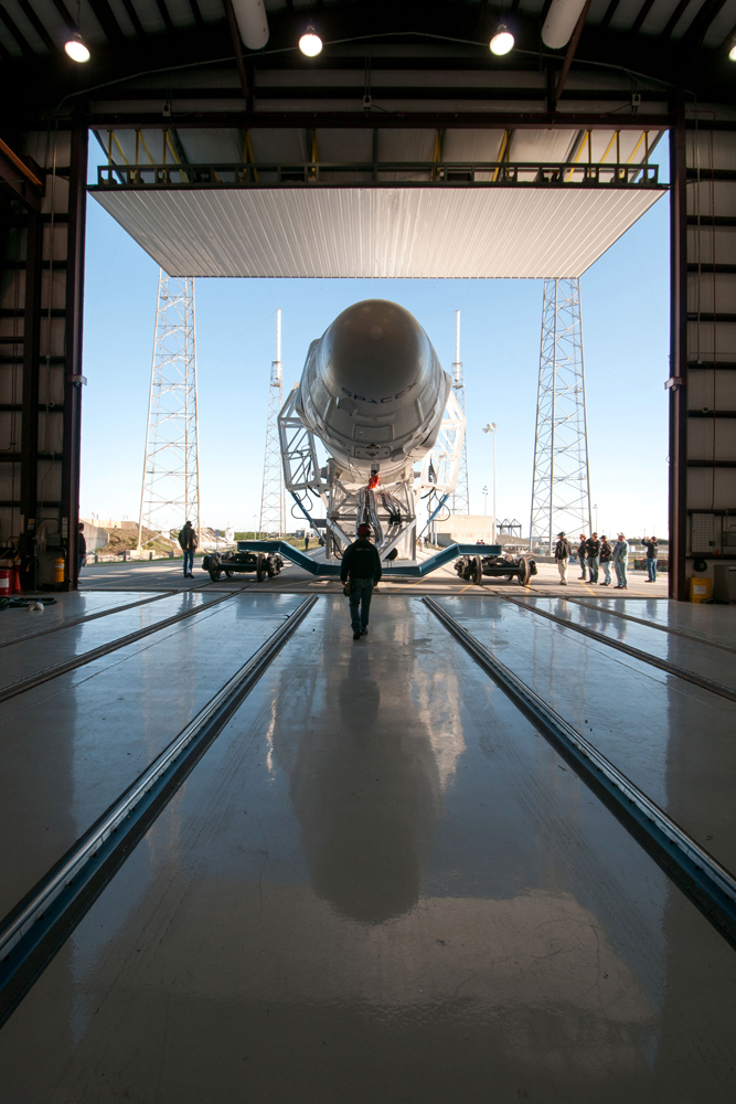 SpaceX's Falcon 9 rocket leaves the hangar at Cape Canaveral, Fla., on March 8, 2013.