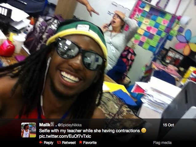 In what some have called the  most inappropriate selfie ever,  student  Malik Whiter took a smiling self portrait in front of his teacher who had just begun going into labor.
