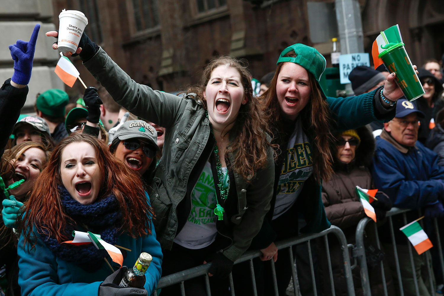 People cheer along 5th avenue during the St. Patrick's Day parade in New York, March 17, 2014.