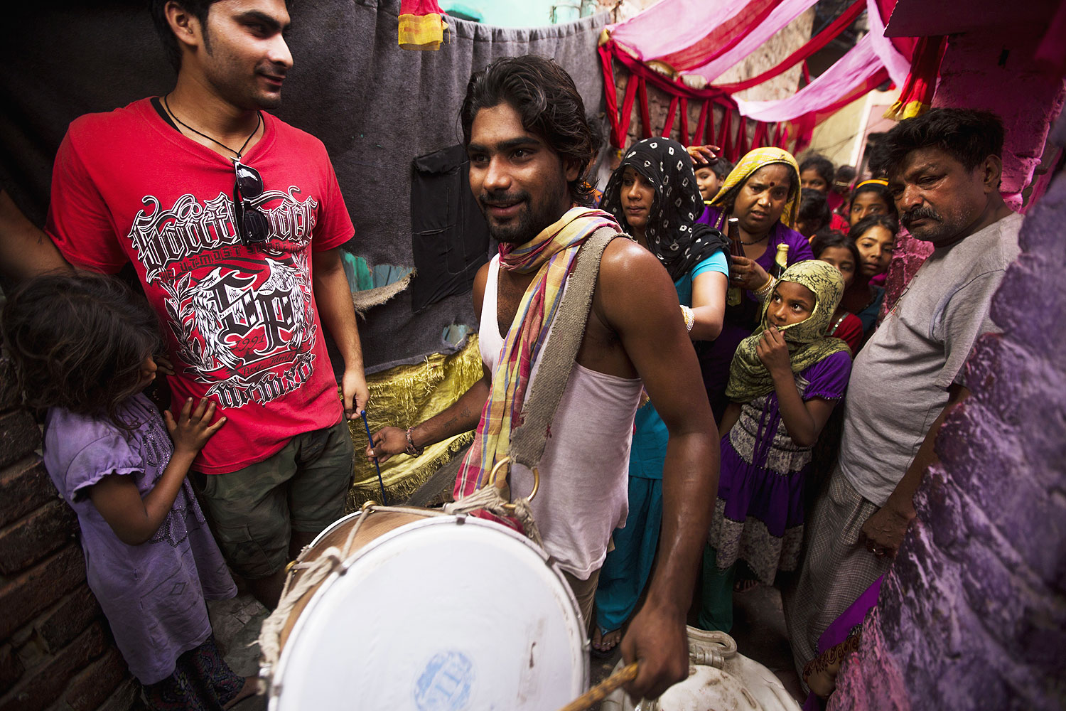 An Indian drummer leads a group of women during a wedding procession in Kathputli Colony in New Delhi, June 2013. The name Kathputli Colony comes from the Hindi word for puppet, and it is an area inhabited by puppeteers, magicians, acrobats, dancers and musicians
