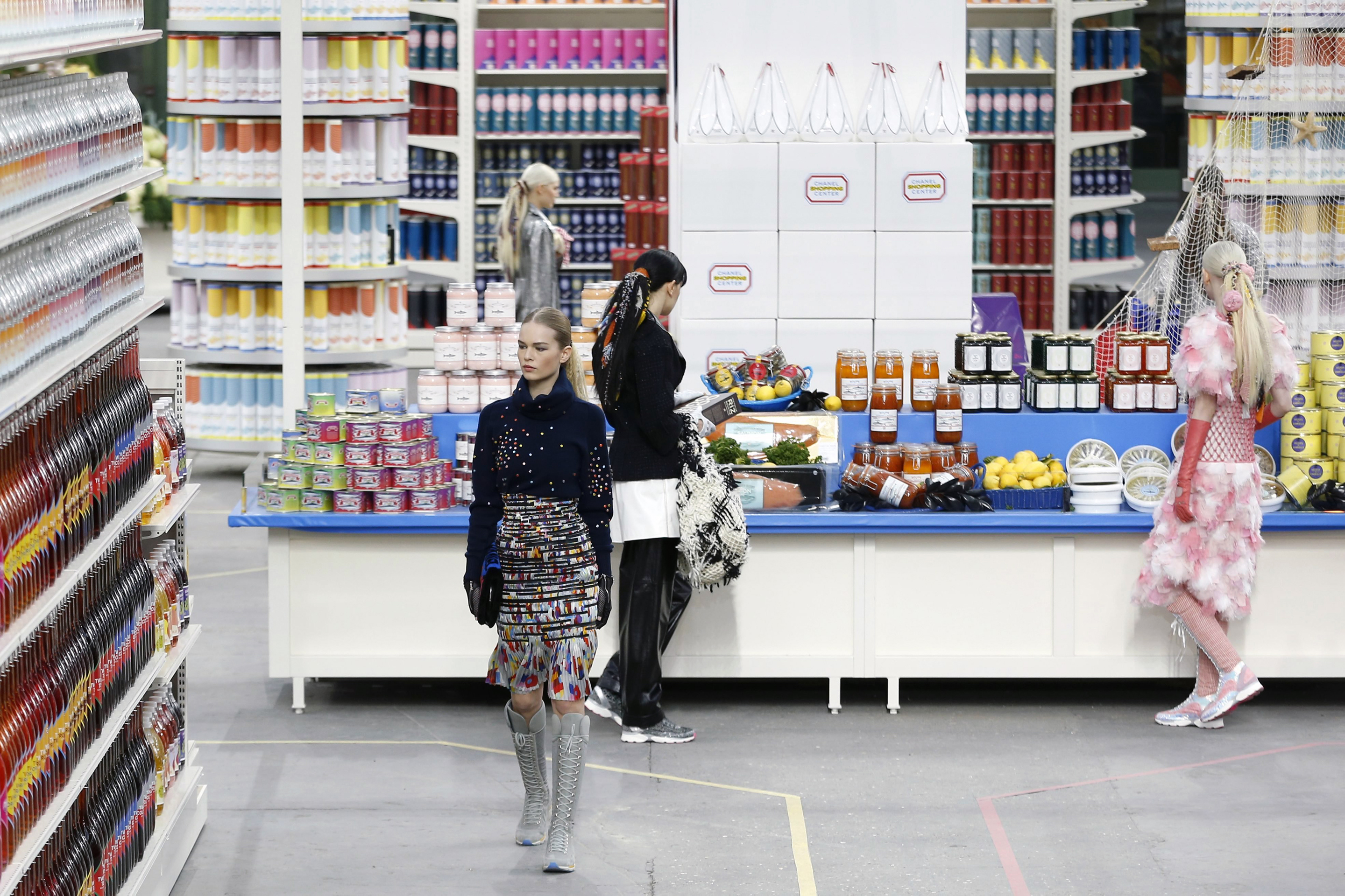 Models present creations from the Fall/Winter 2014/15 Ready to Wear Collection by German designer Karl Lagerfeld for French label Chanel in Paris March 4, 2014.