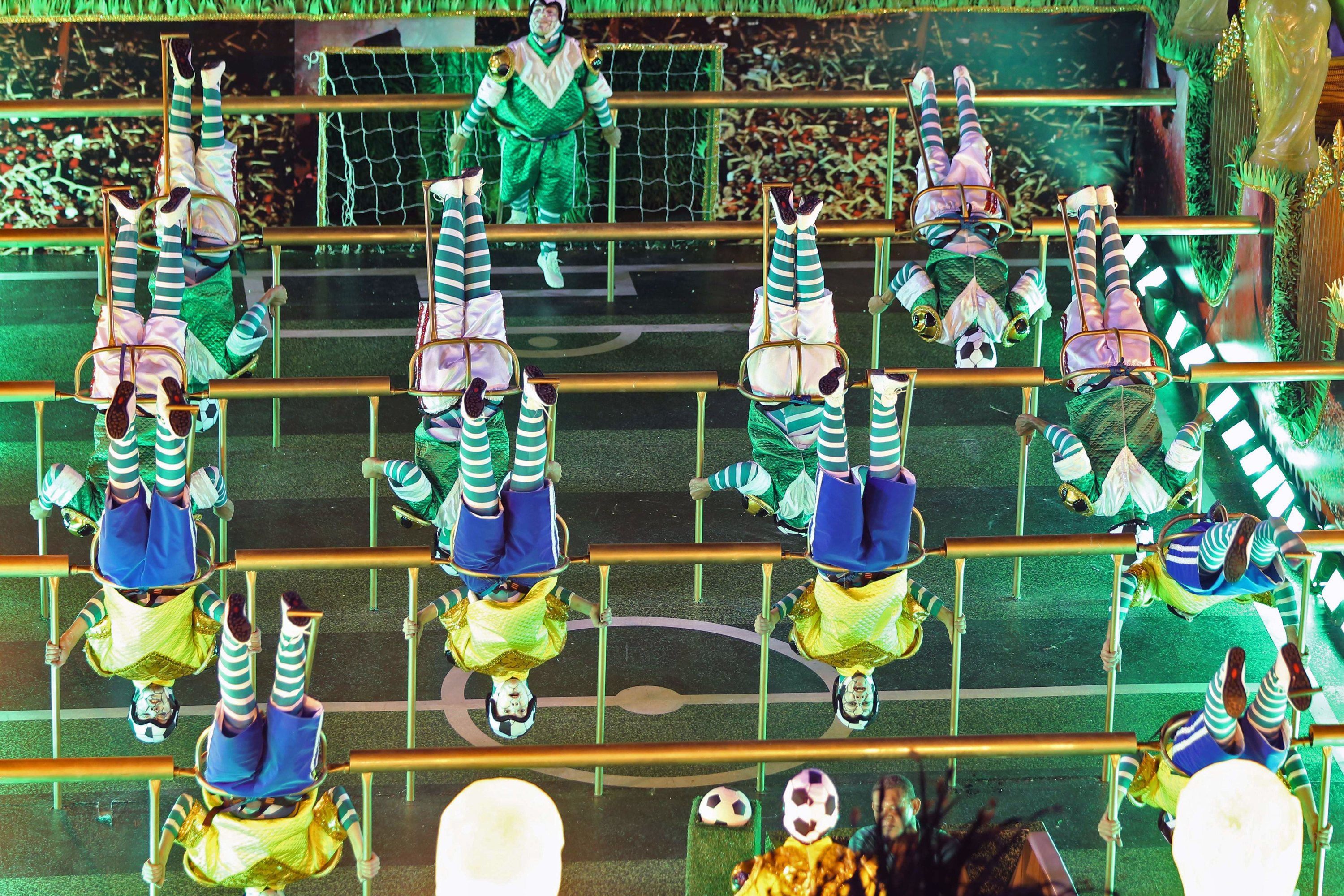 Revelers of the Imperatriz samba school perform during the second night of carnival parade at the Sambadrome in Rio de Janeiro March 4, 2014.