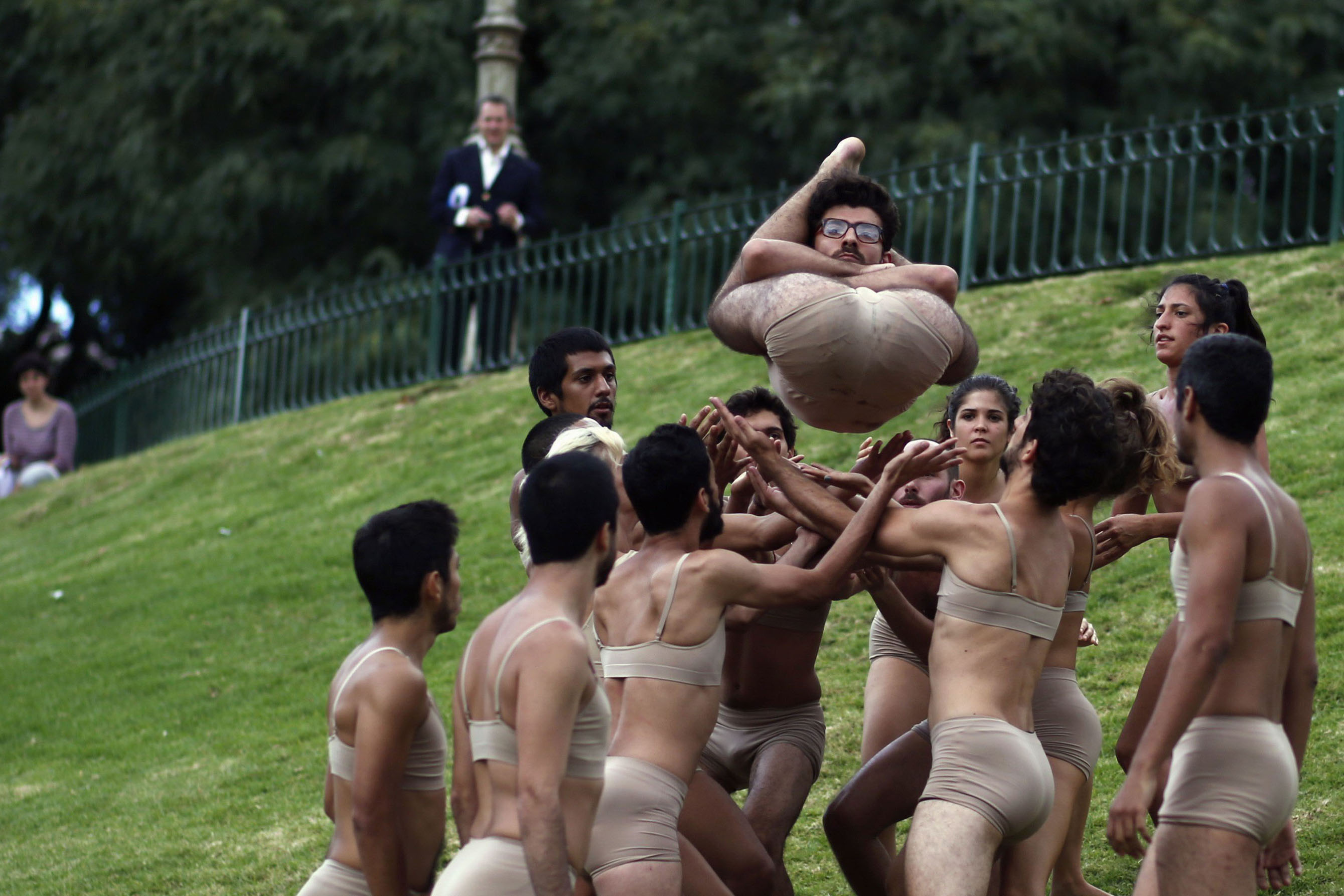 Members of the IUNA Ballet perform during a rehearsal of their show,  Dressed by Grace,  at a public square ahead of the Ciudanza Dance Festival in Buenos Aires March 5, 2014.