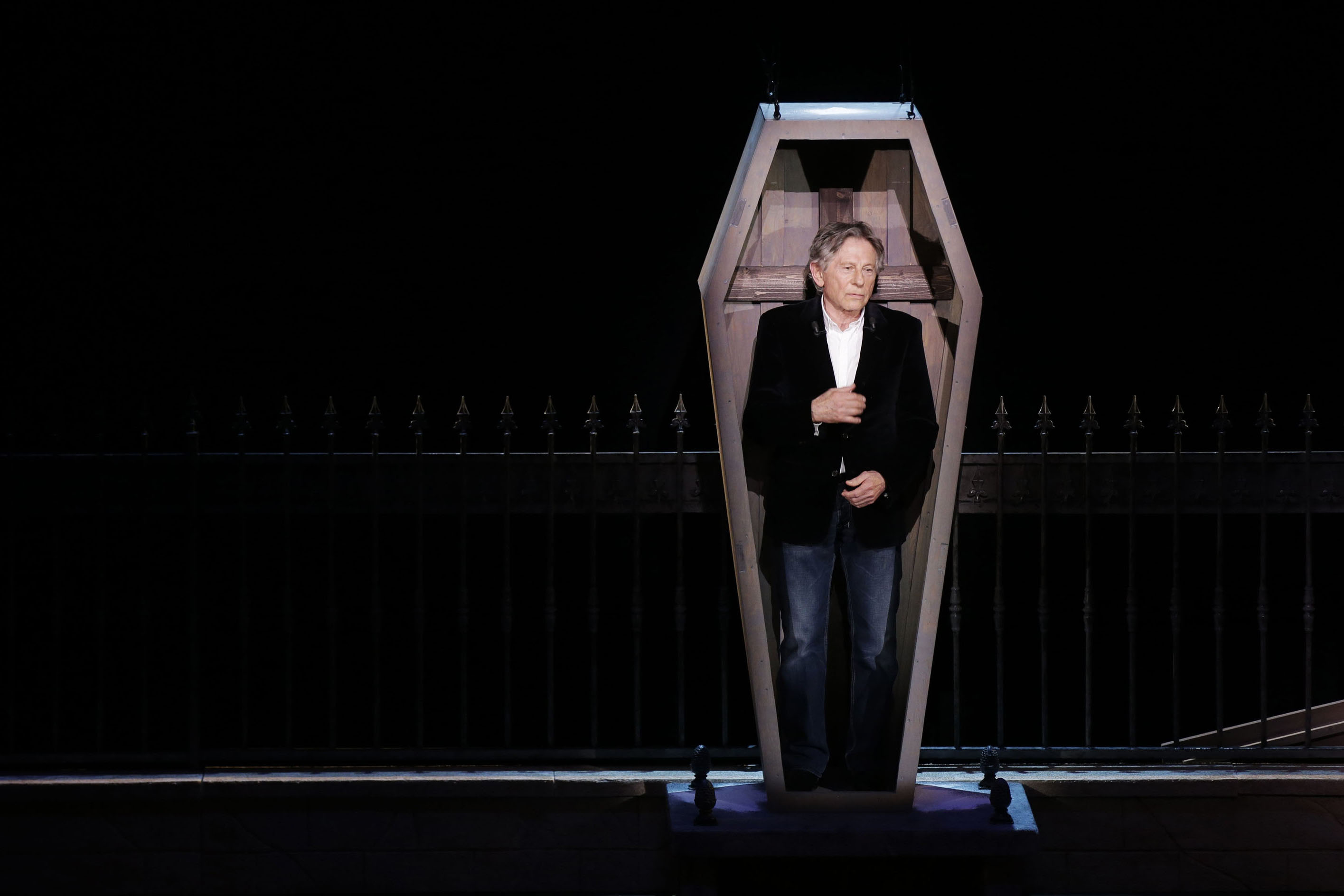 Polish-French film director Roman Polanski stands in a coffin as he takes part in the presentation of the musical  Le Bal des Vampires  (Dance of the Vampires) at the Mogador theatre in Paris March 17, 2014.