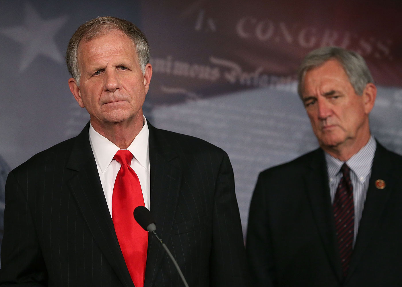 Ted Poe (R-TX) (L) and U.S. Rep.  Rick Nolan (D-MN) participate in a news conference on the sex slave industry, on Capitol Hill, August 1, 2013 in Washington, DC.
