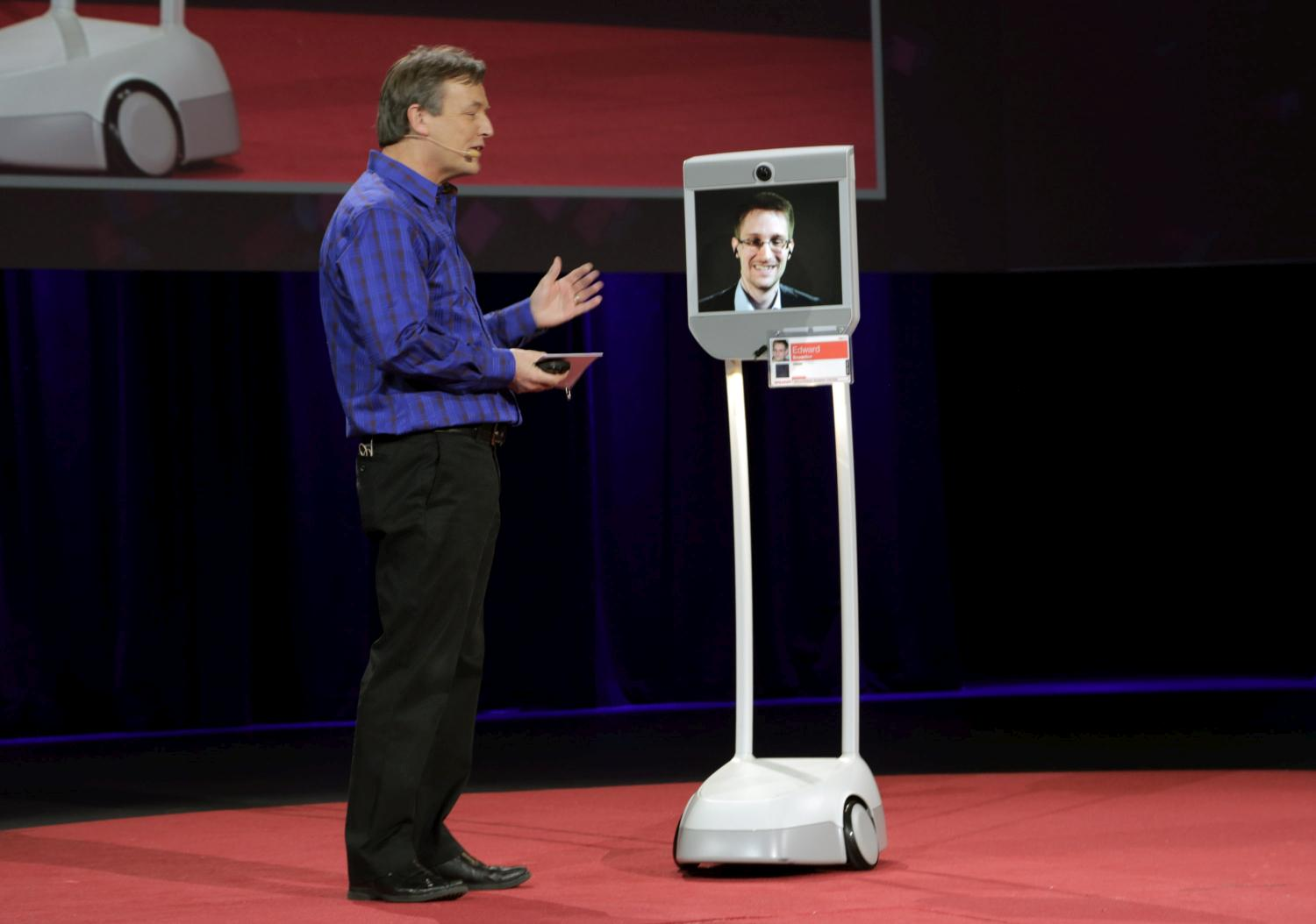 Edward Snowden is interviewed by TED Curator Chris Anderson (L) via a BEAM remote presence system during the 2014 TED conference March 18, 2014 in Vancouver, Canada.