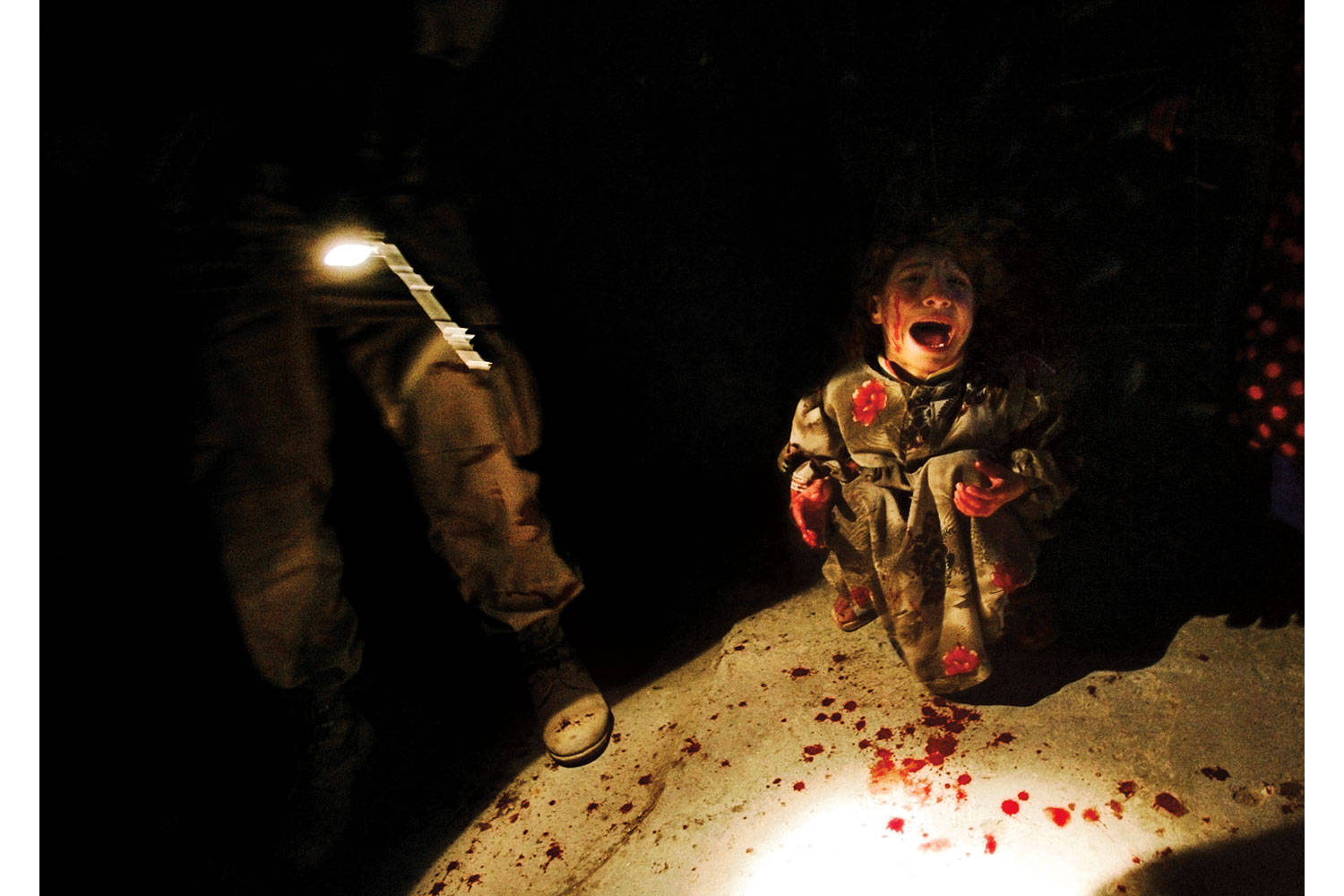 From Chris Hondros' Testament,                               Samar Hassan, 5, screams after her parents were killed by U.S. soldiers.