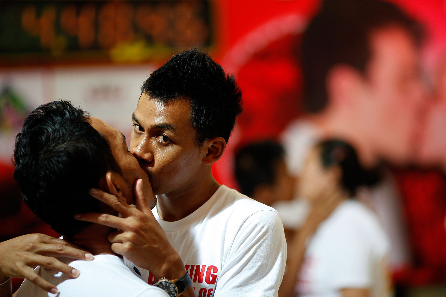 Two men kiss among straight couples participating in a longest continuous kiss competition in Pattaya, Thailand, in Feb. 2012