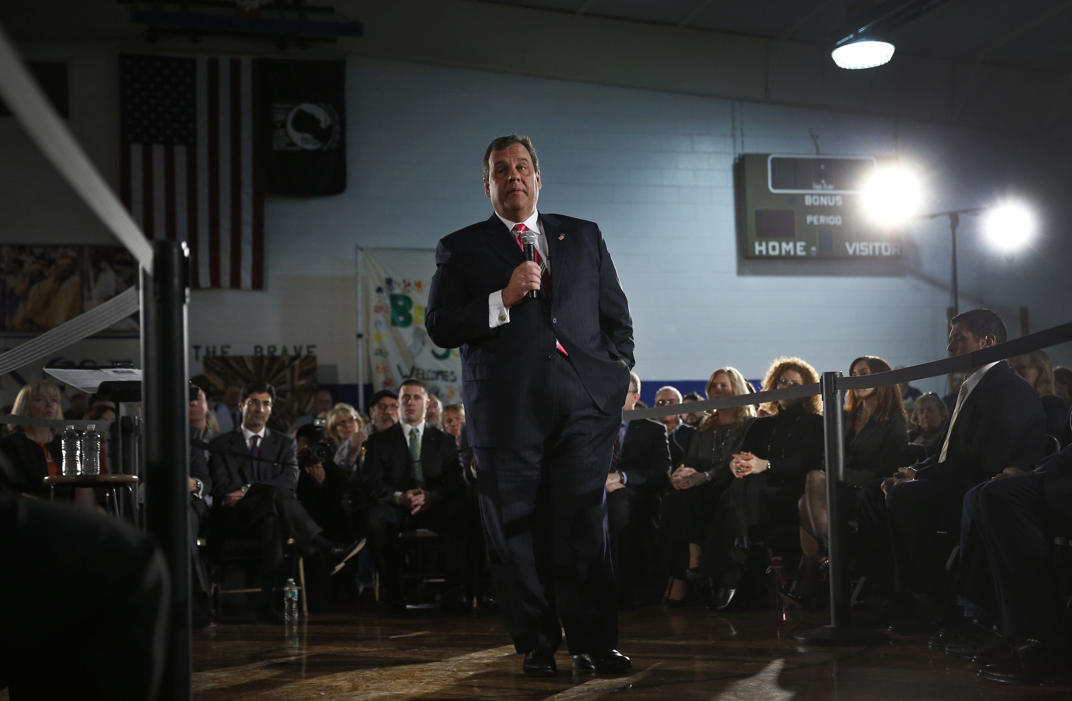 New Jersey Governor Chris Christie speaks to local residents of Belmar, New Jersey, March 25, 2014.