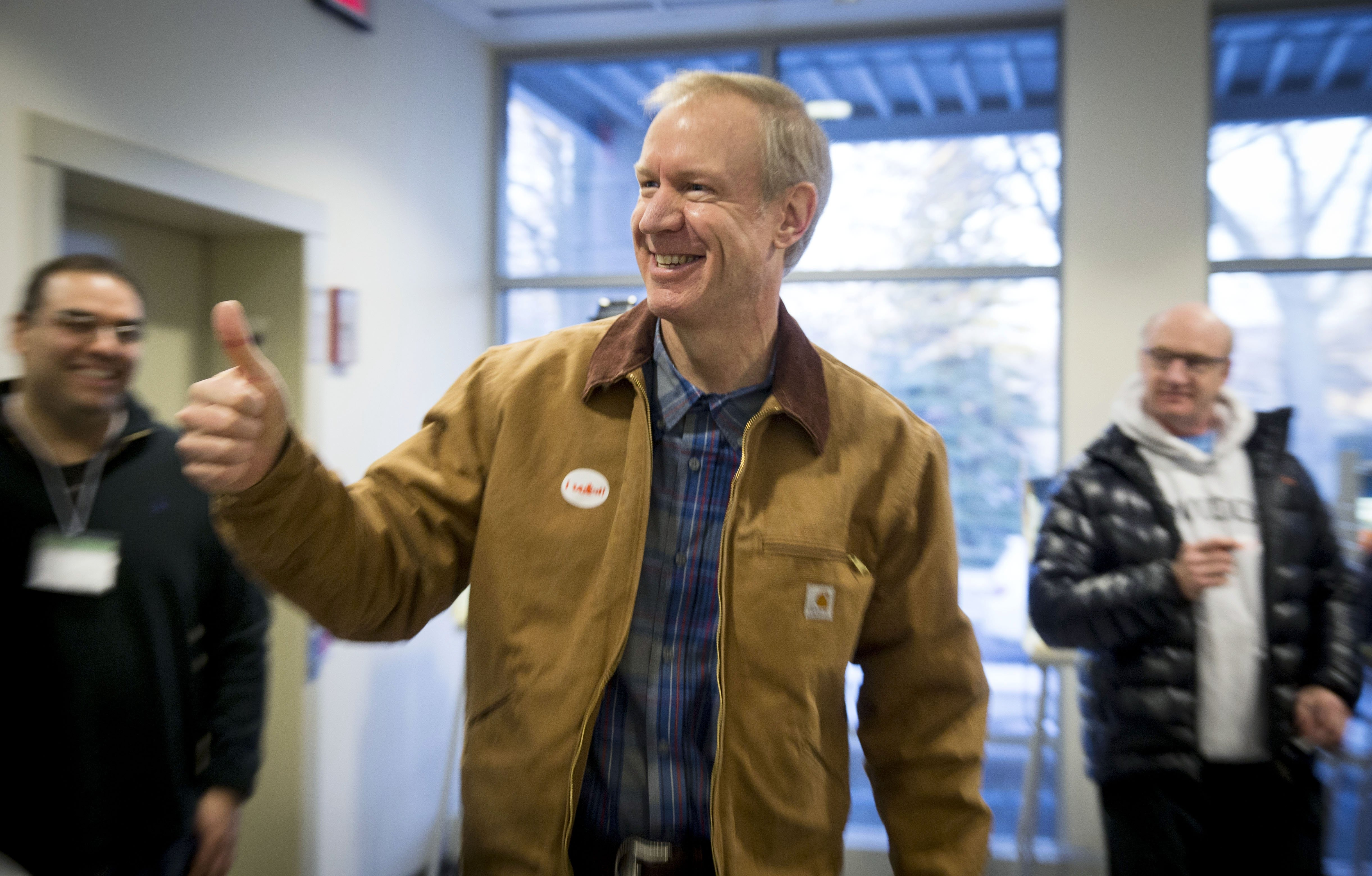Illinois Republican gubernatorial candidate Bruce Rauner exits the polling place after voting in Winnetka, Ill., March 18, 2014.