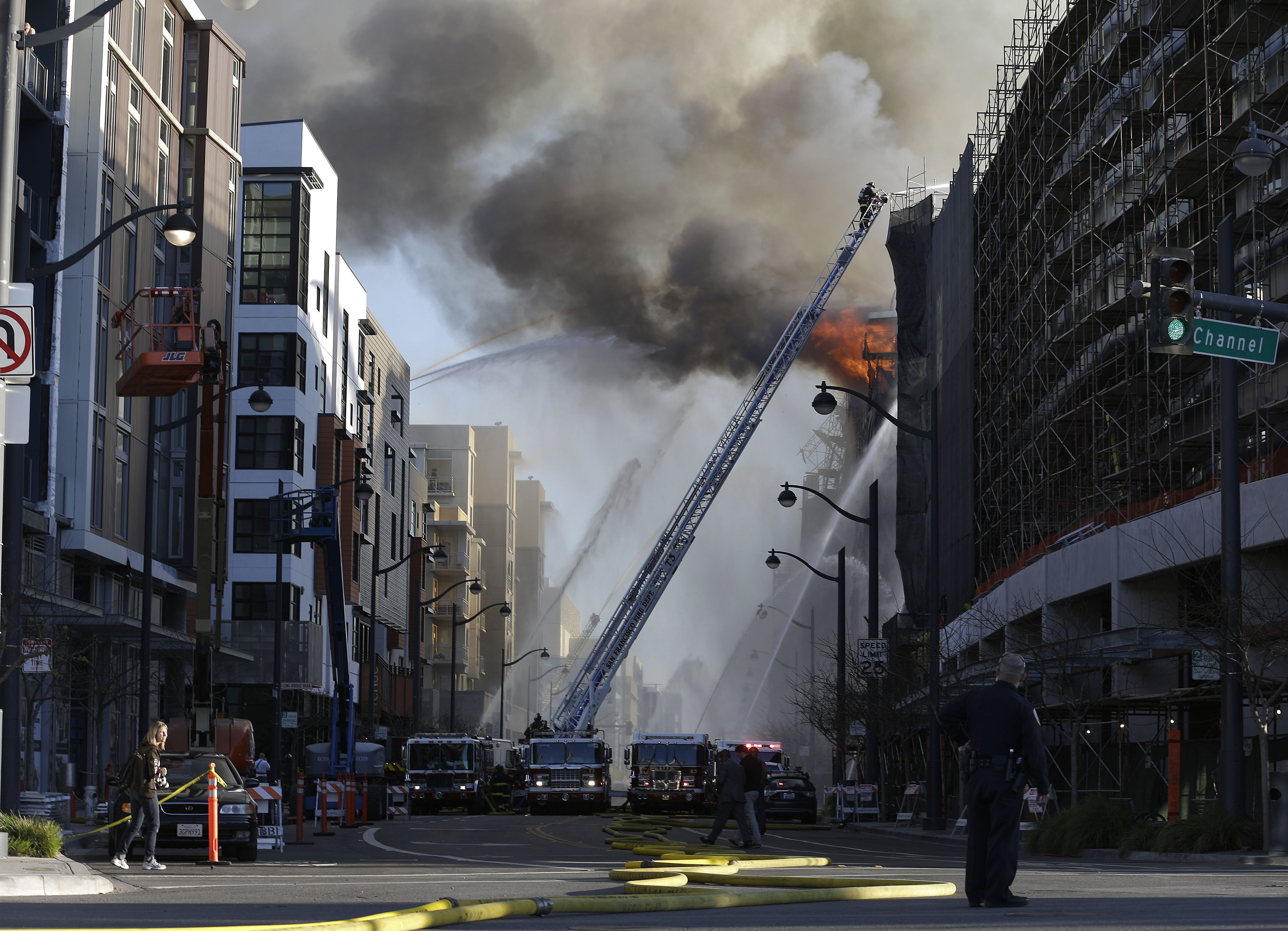 Firefighters battle a fire burning in San Francisco, March 11, 2014.