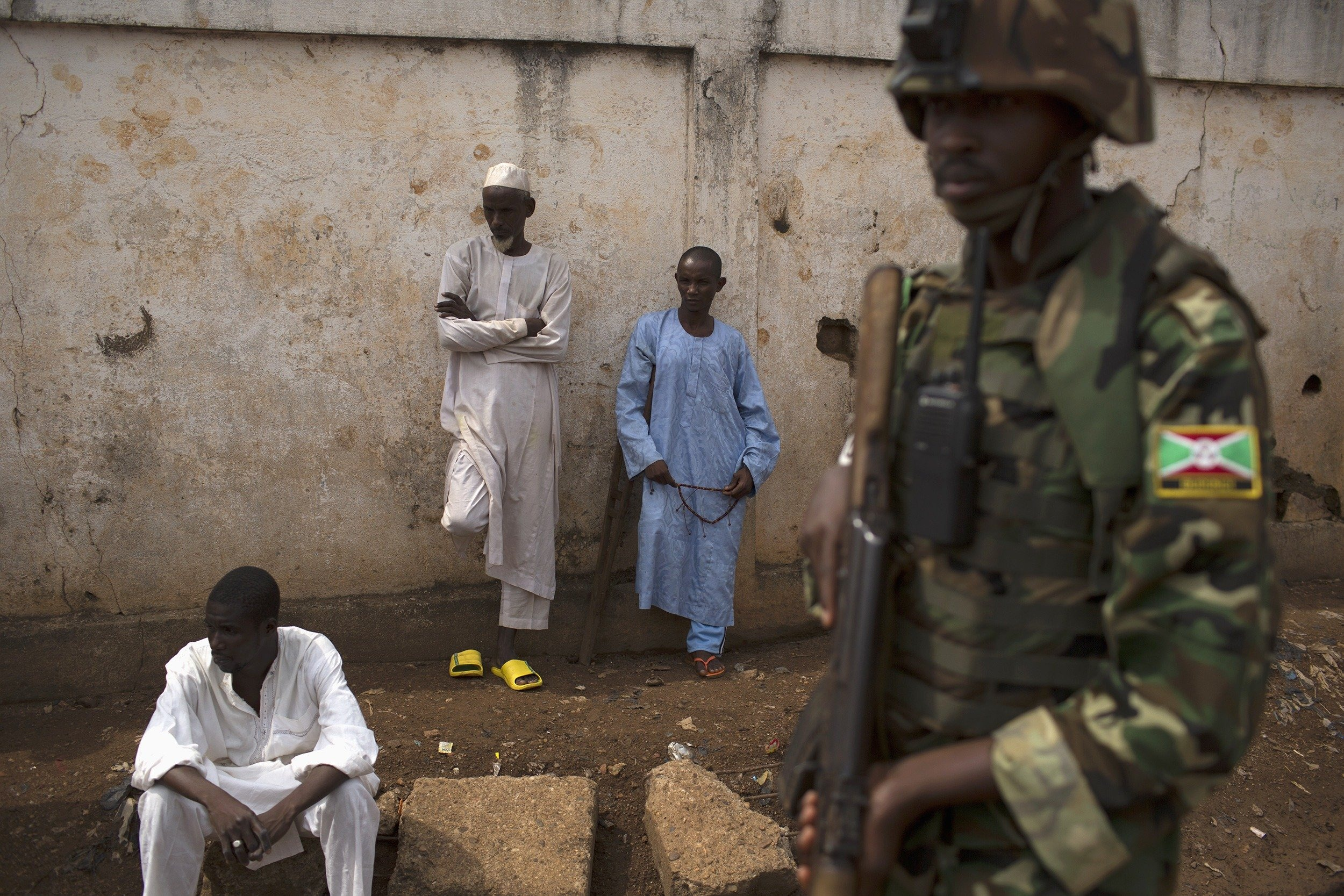 An African Union soldier stands guard outside a home at the end of a funeral of two men killed in the Muslim neighborhood of PK-5, in Bangui, on March 23, 2014.