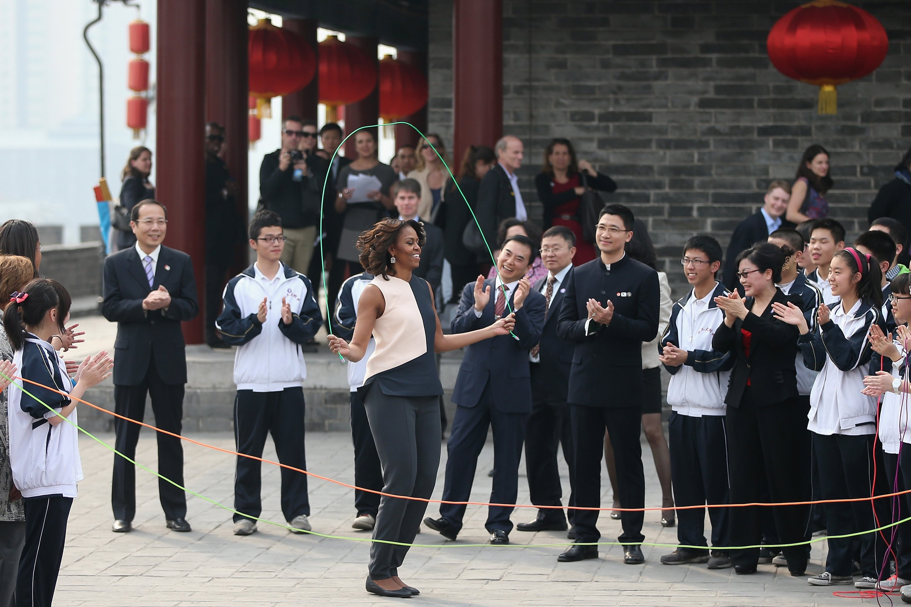 First Lady Michelle Obama jumps rope with Chinese schoolchildren during her visit to the Xi'an City Wall on March 24, 2014 in Xi'an, China.