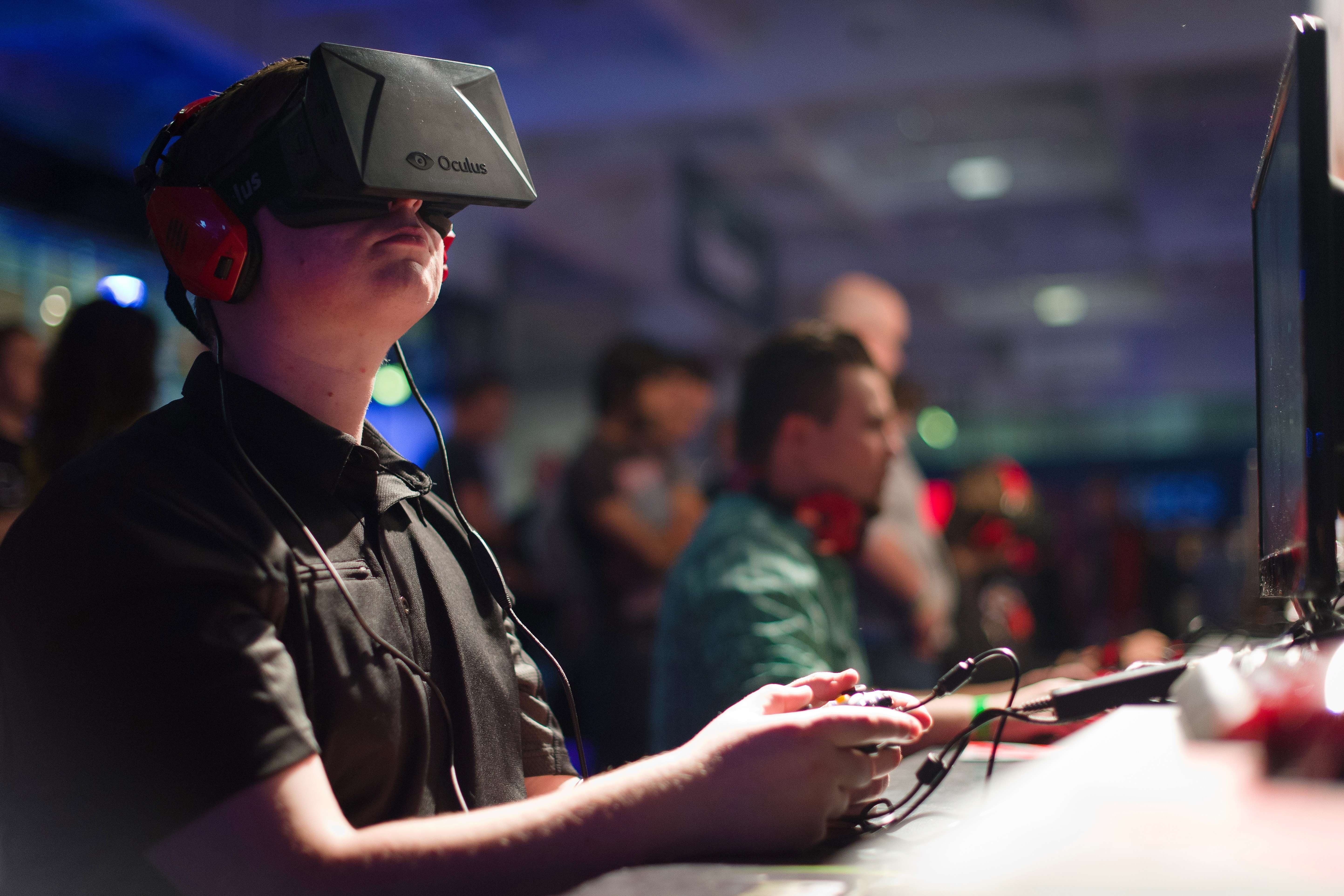 A gamer uses an Oculus virtual reality headset at the Eurogamer Expo 2013 in London, September 26, 2013.