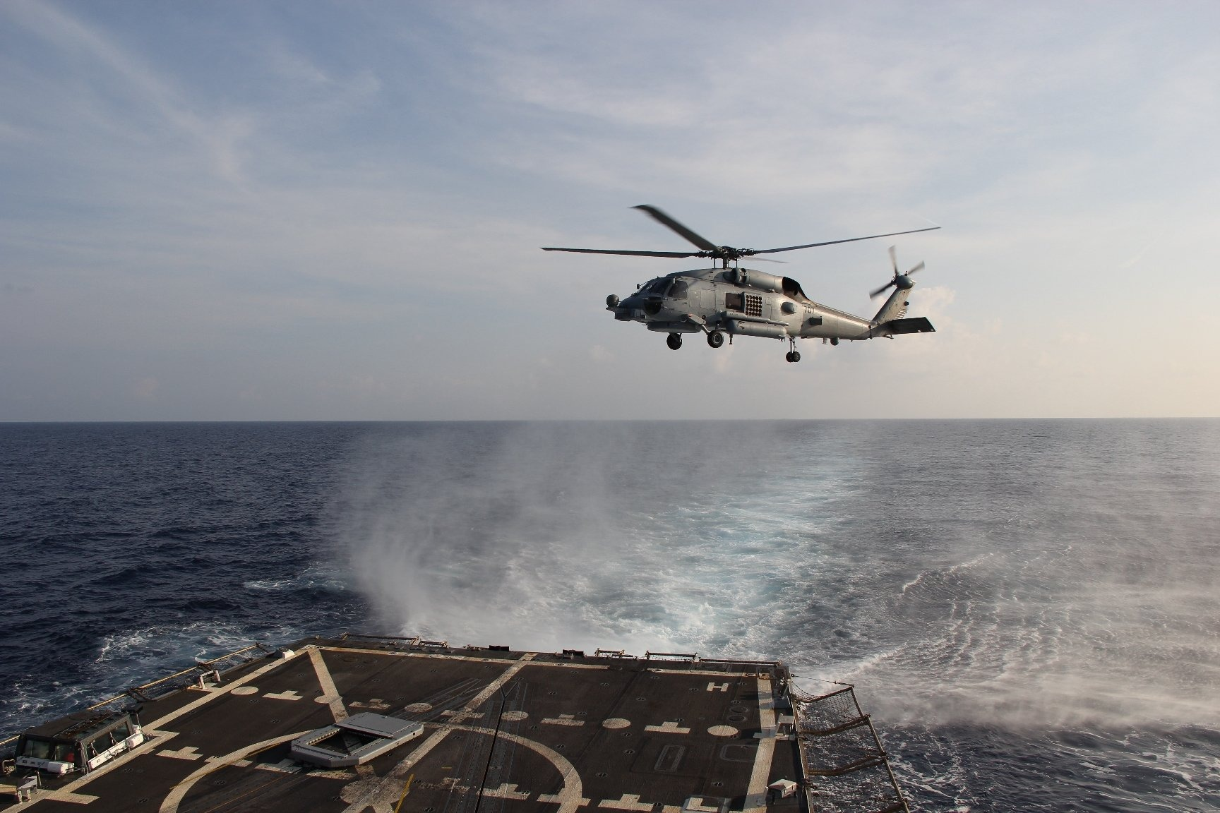 A Sea Hawk helicopter departs from the U.S.S. Pinckney to search for the missing Malaysia Airlines aircraft on March 9, 2014