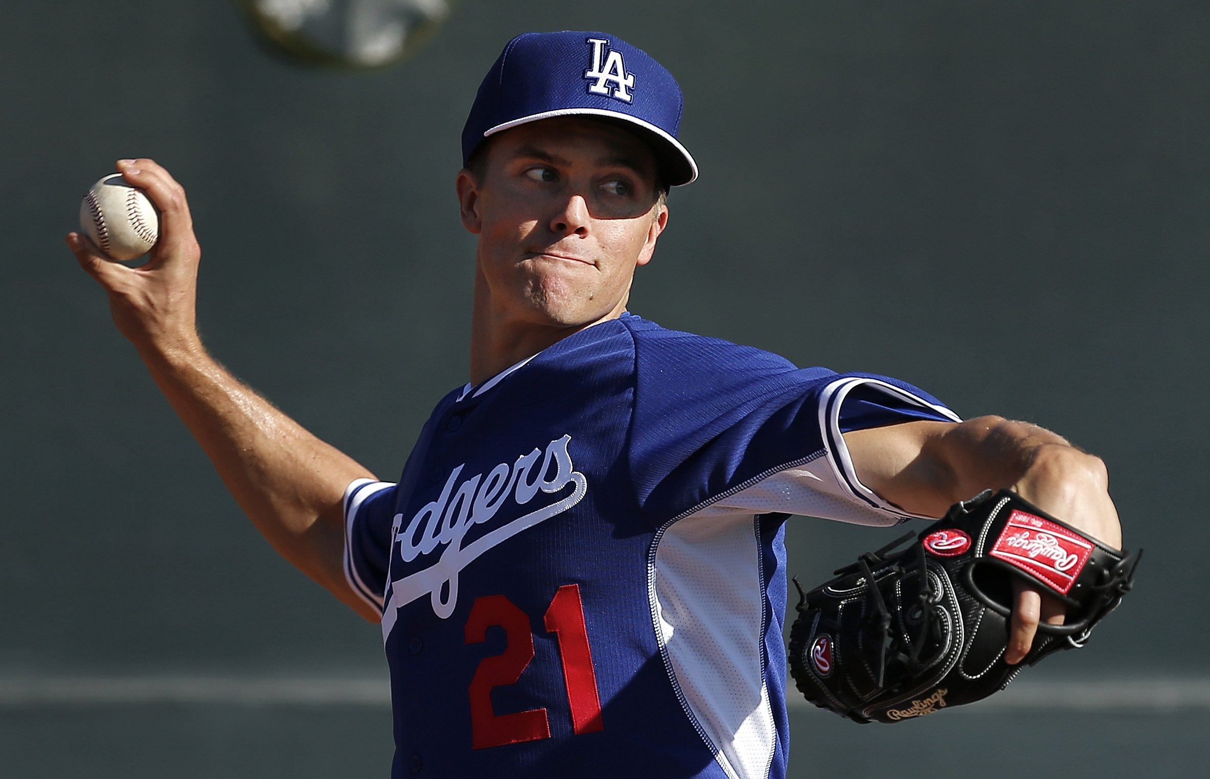 Los Angeles Dodgers pitcher Zack Greinke throws during spring training baseball practice in Glendale, Ariz., Feb. 10, 2014.