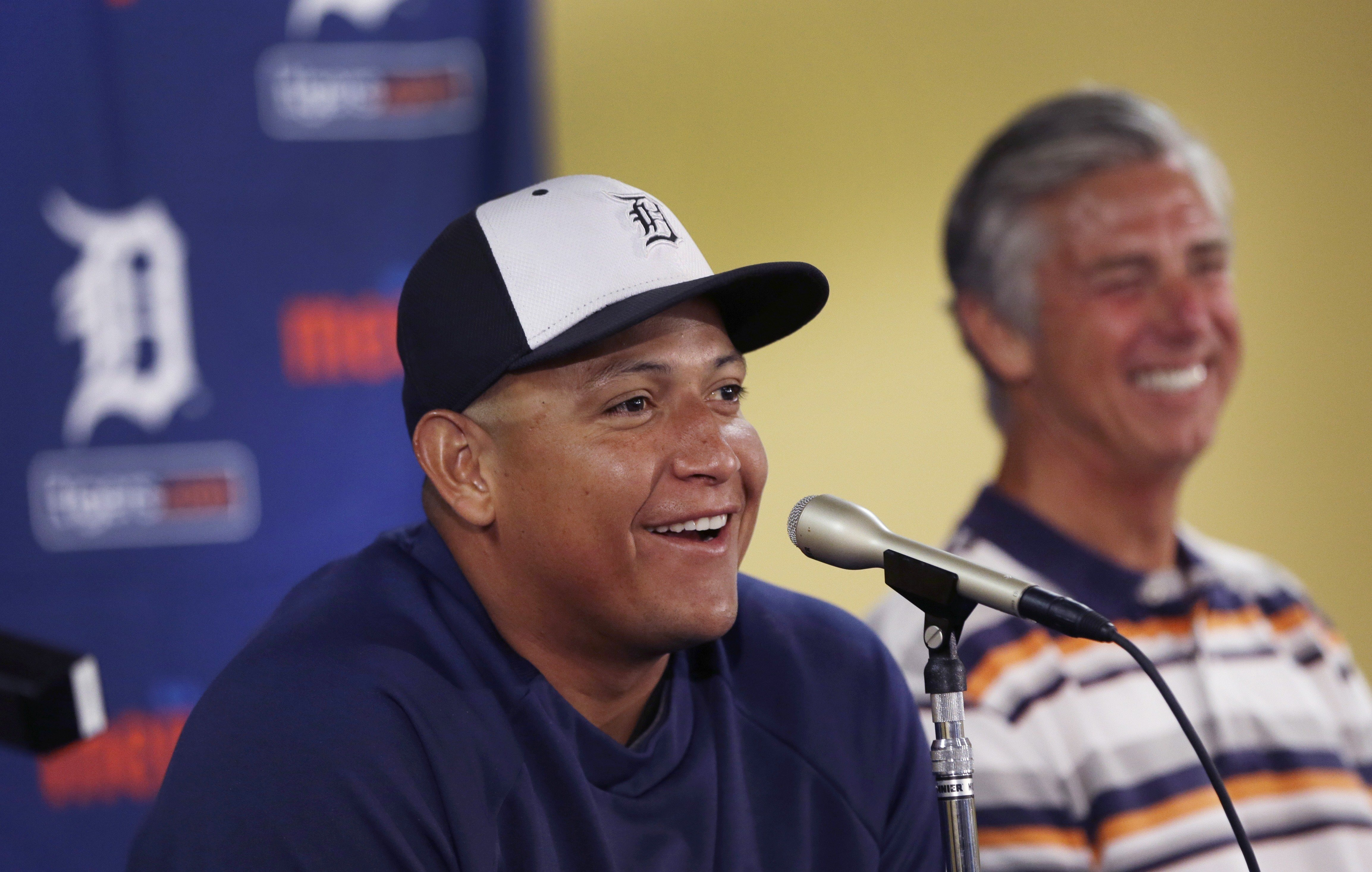 Detroit Tigers first baseman Miguel Cabrera with Tigers President, CEO and General Manager David Dombrowski during a news conference in Lakeland, Fla., March 28, 2014.
