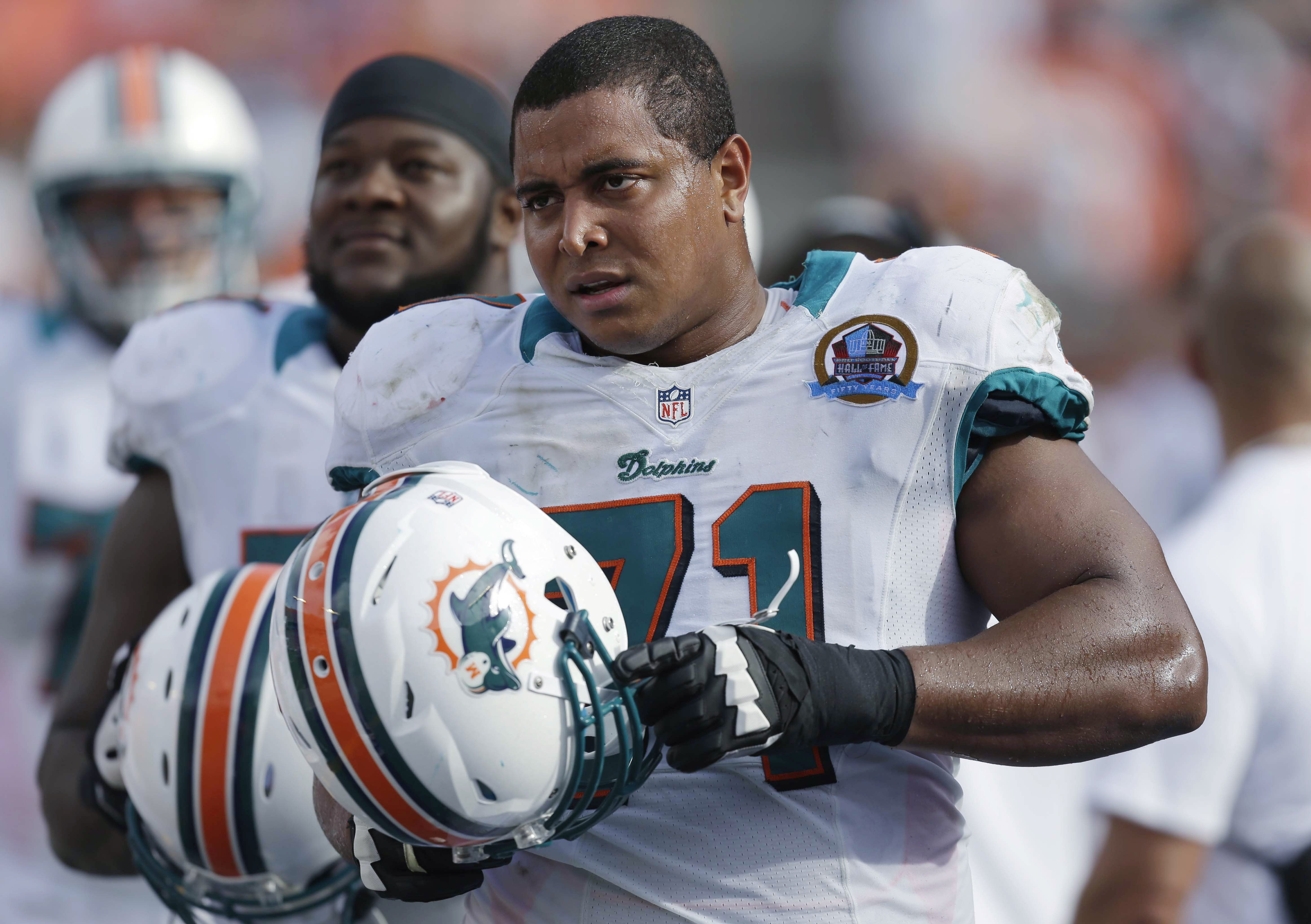 Miami Dolphins tackle Jonathan Martin stands on the sidelines during a Dolphins game in Miami, Dc. 16, 2012.