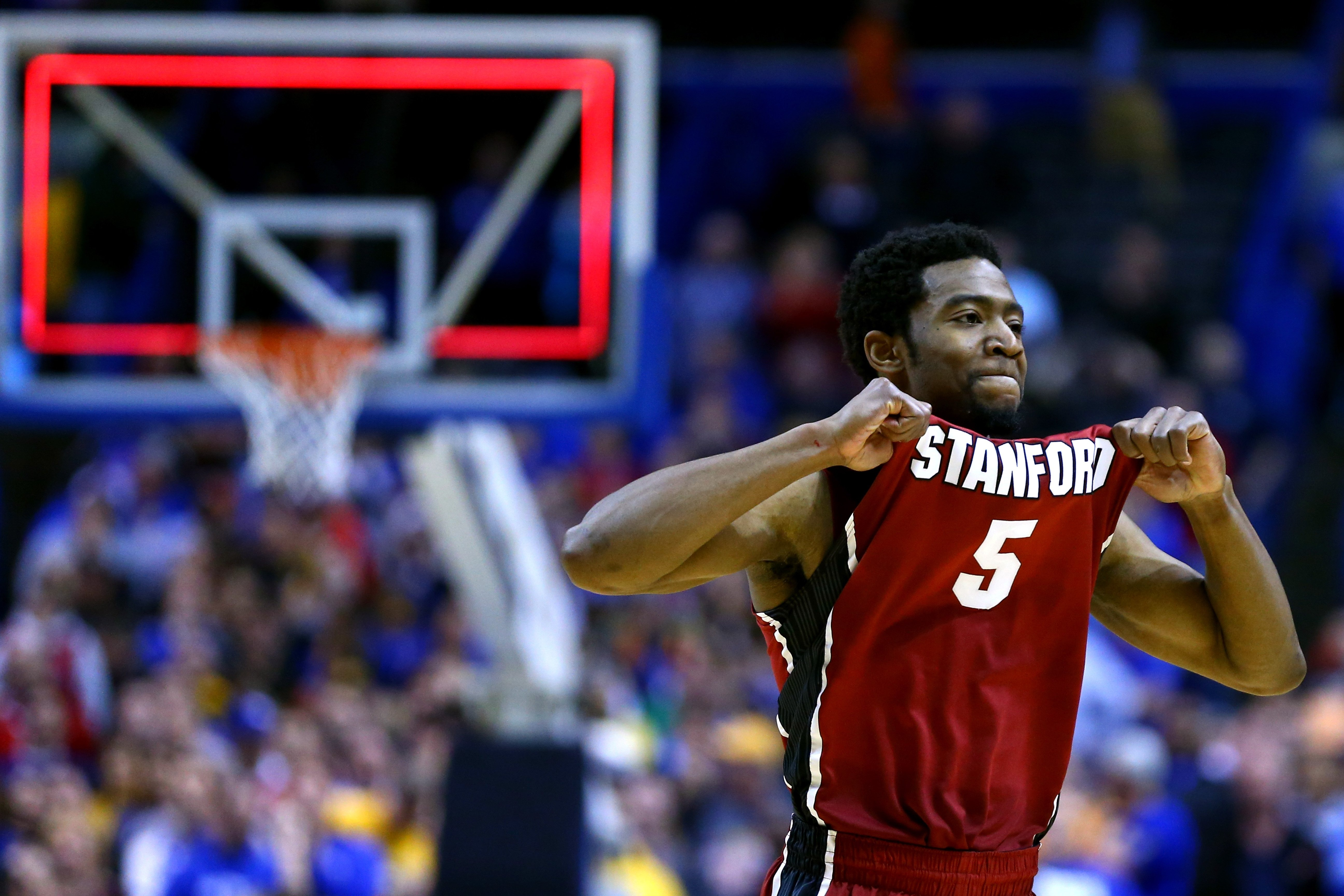 Chasson Randle of the Stanford Cardinal celebrates defeating the Kansas Jayhawks 60 to 57 during the third round of the 2014 NCAA Men's Basketball Tournament at Scottrade Center on March 23, 2014 in St Louis, Missouri.