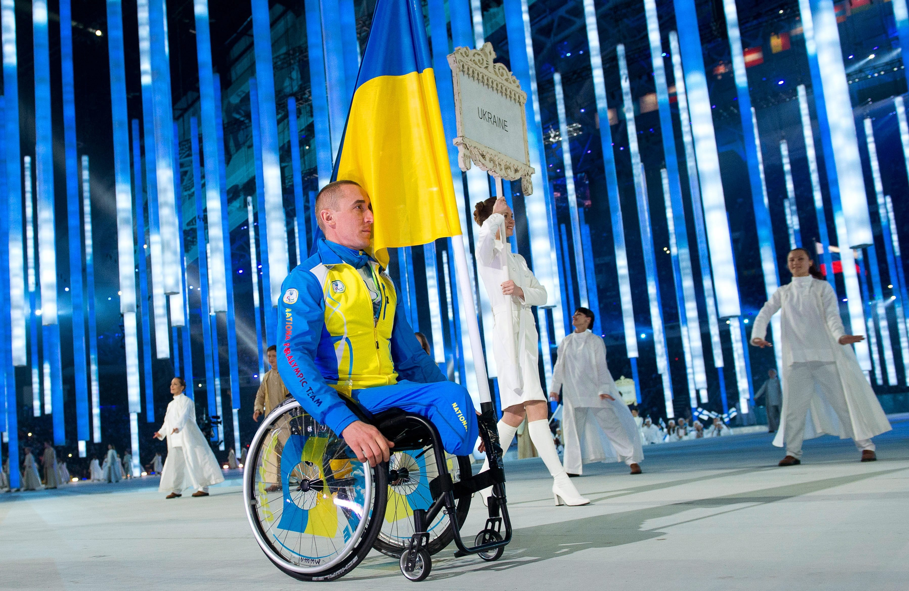 Flag bearer Mykhaylo Tkachenko of Ukraine attends the Opening Ceremony of the Sochi 2014 Winter Paralympic Games at Fisht Olympic Stadium in Sochi, Russia, March 07 2014.